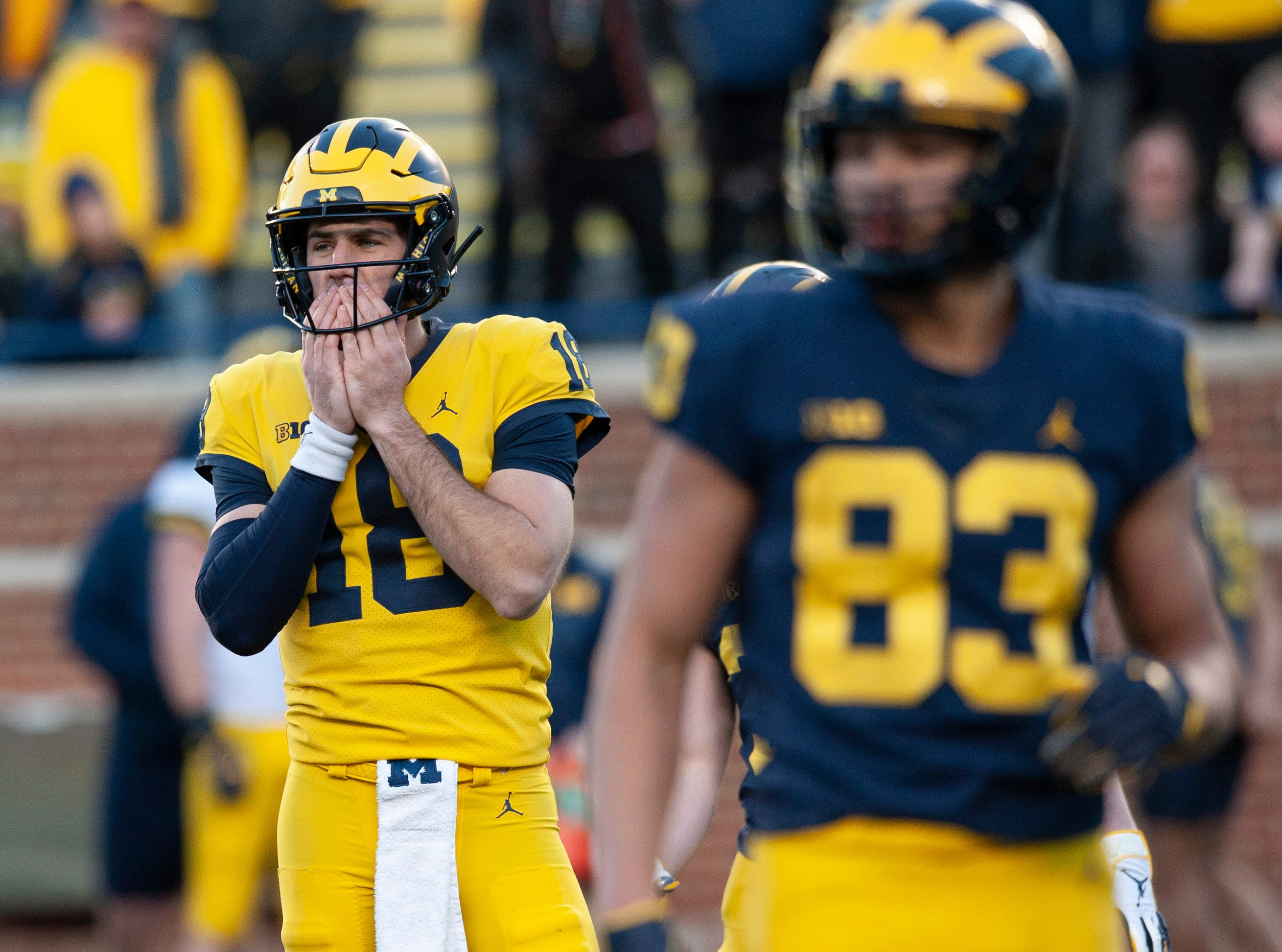 Michigan QB Brandon Peters looks to the sidelines for instruction.