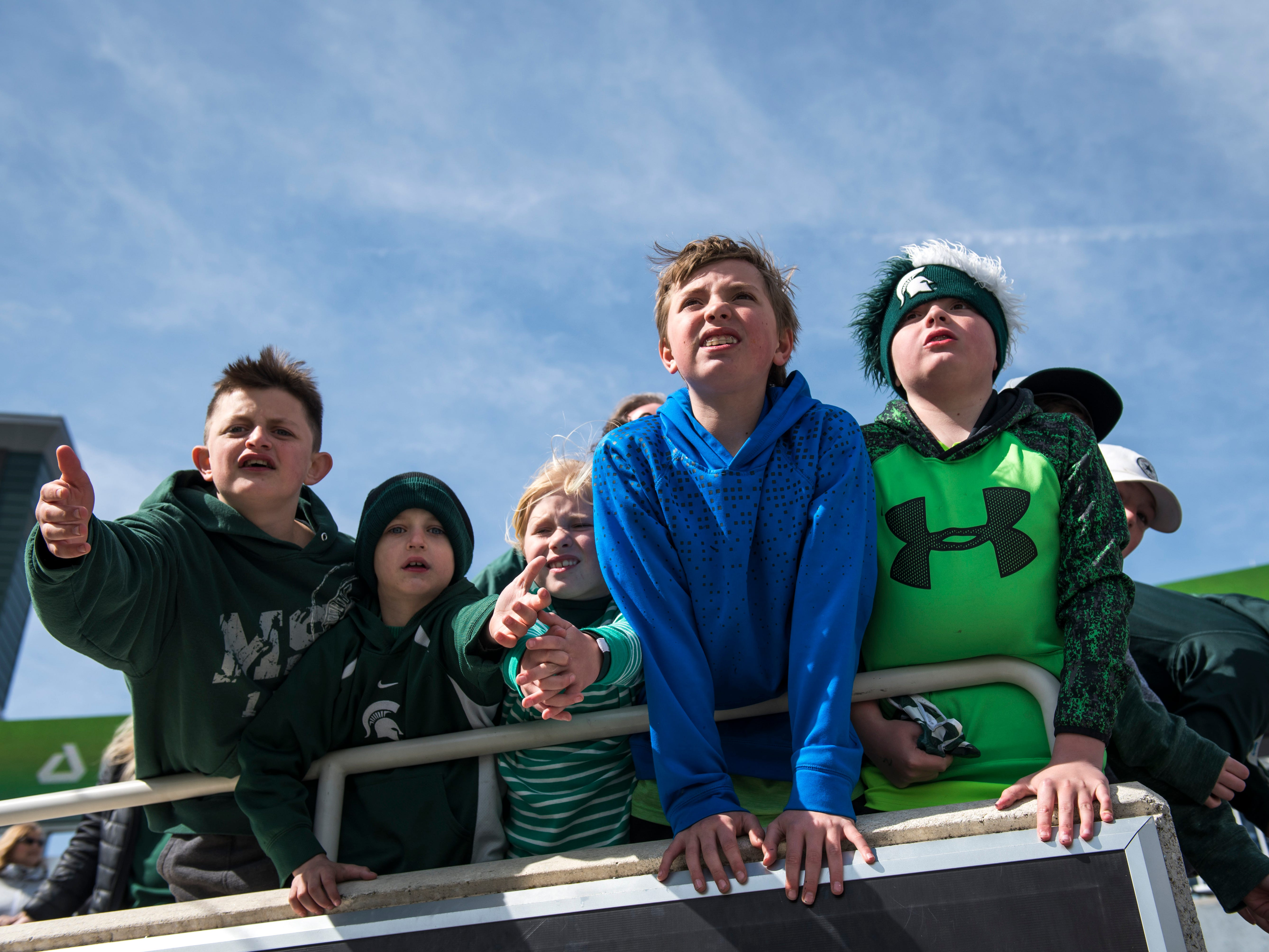 Spartan fans wait for players to leave the field.