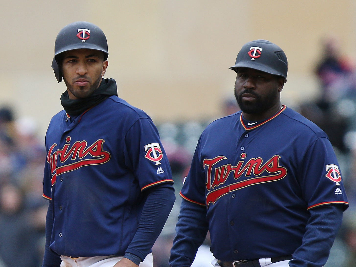 Minnesota Twins' Eddie Rosario stands on first base next to first base coach Tommy Watkins during a baseball game against the Detroit Tigers, Saturday, April 13, 2019, in Minneapolis. The Twins won 4-3. (AP Photo/Stacy Bengs)