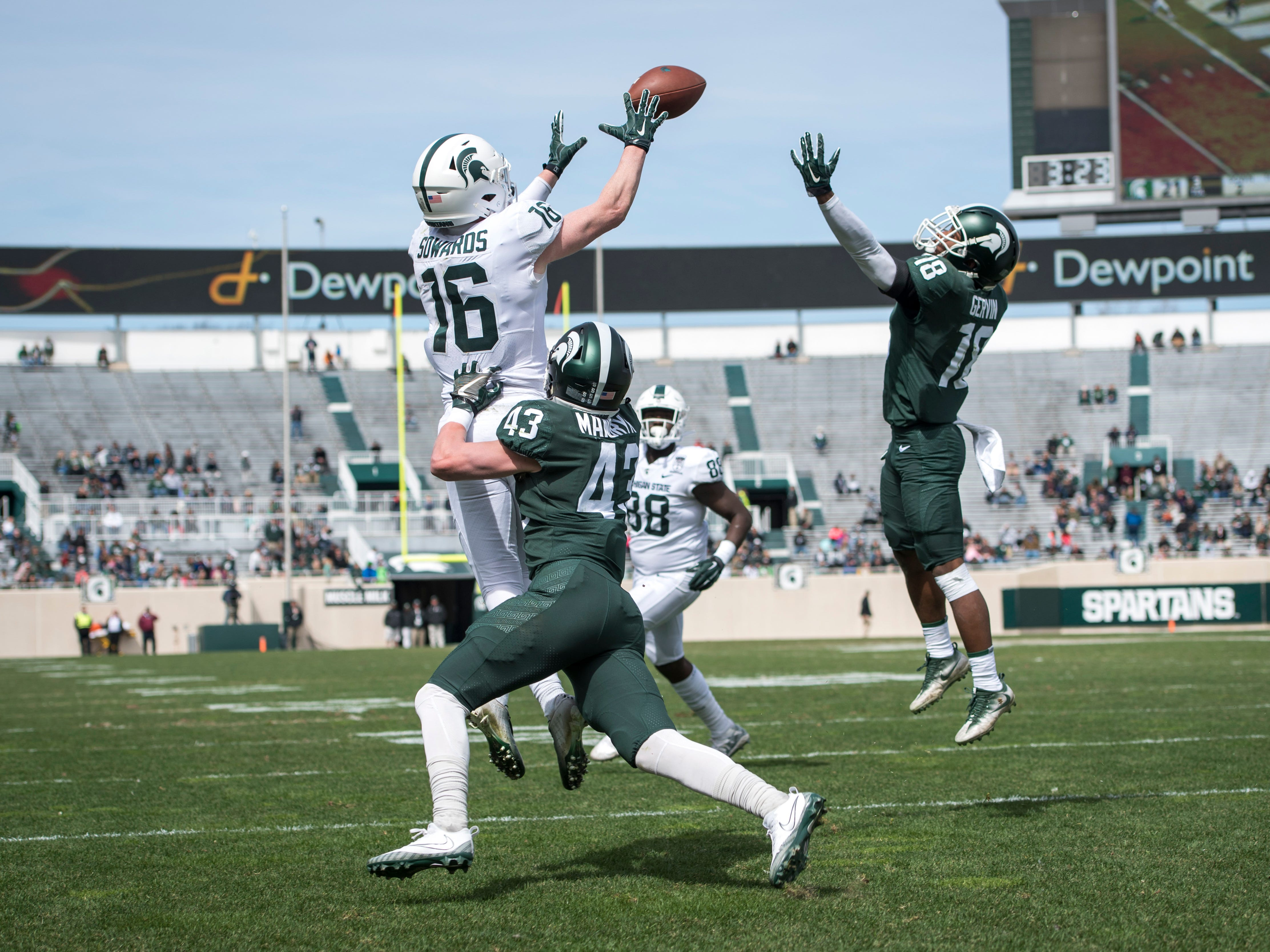 Wide receiver Brandon Sowards jumps to receive a a pass while being covered by safety Jack Mandryk.