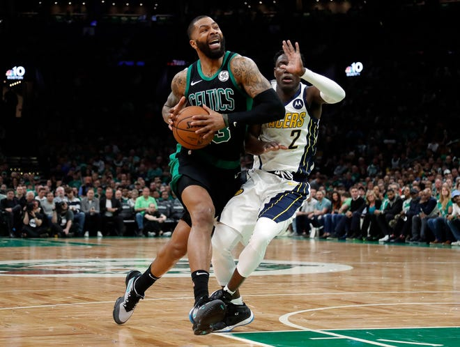 Boston Celtics' Marcus Morris, left, drives past Indiana Pacers' Darren Collison during the second quarter on Sunday.