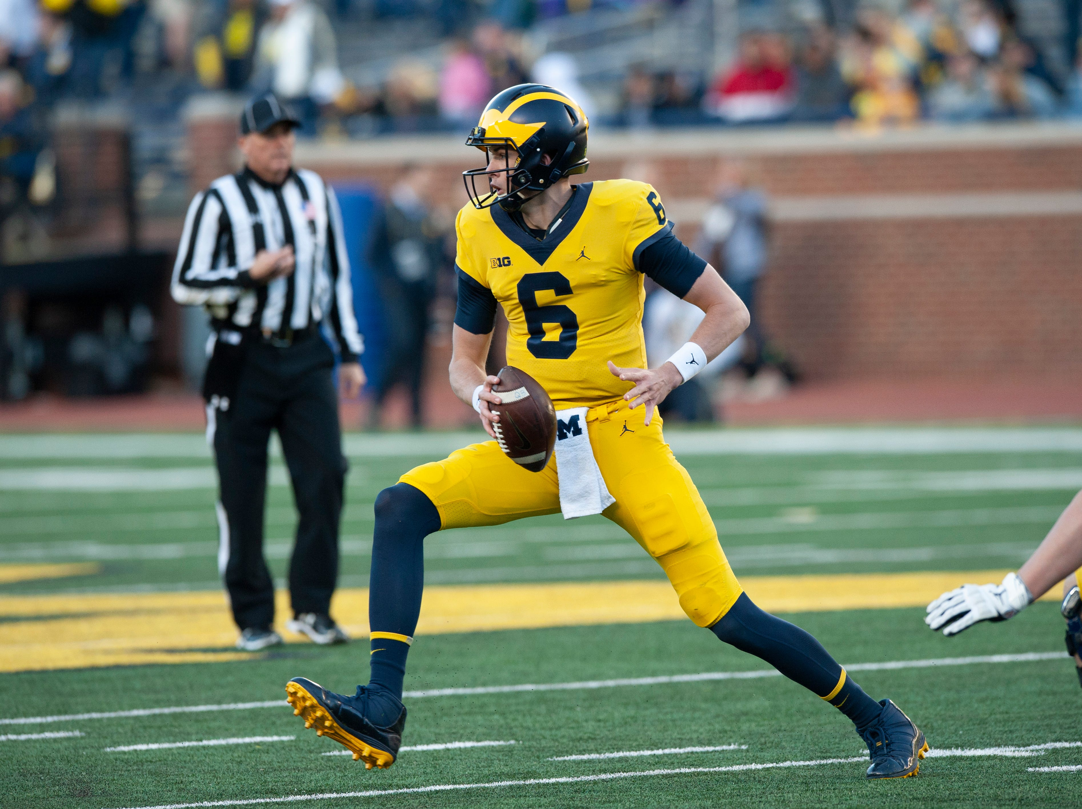 Michigan QB Michael Sessa gets ready to pitch the football in the backfield.