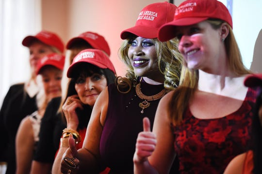 Republican women for President Trump, wearing Make America Great Again hats,   give a thumbs up during the Style Show at the Trumperware event in Flushing.