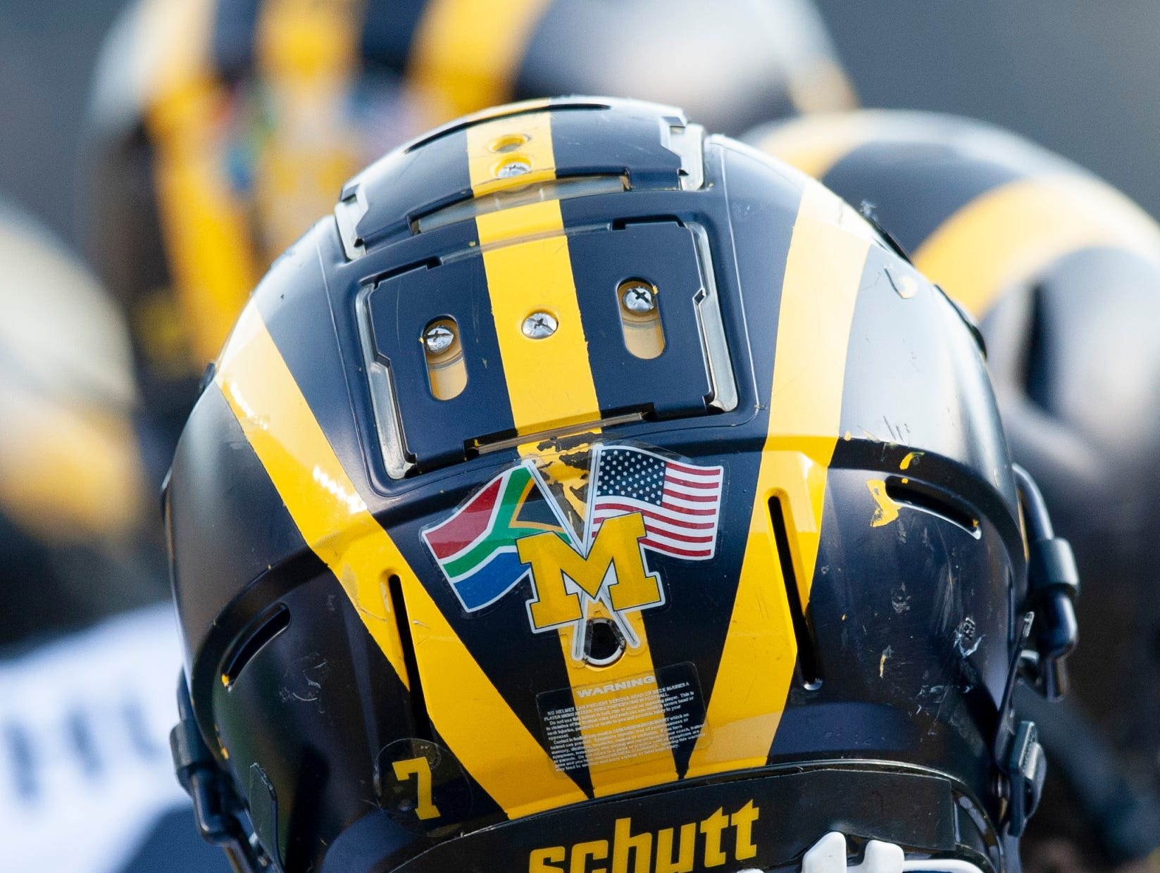The South African flag and the American flag on the back of the players' helmets, like this one worn by LB Khaleke Hudson, is in honor of the summer trip the team will take to South Africa.