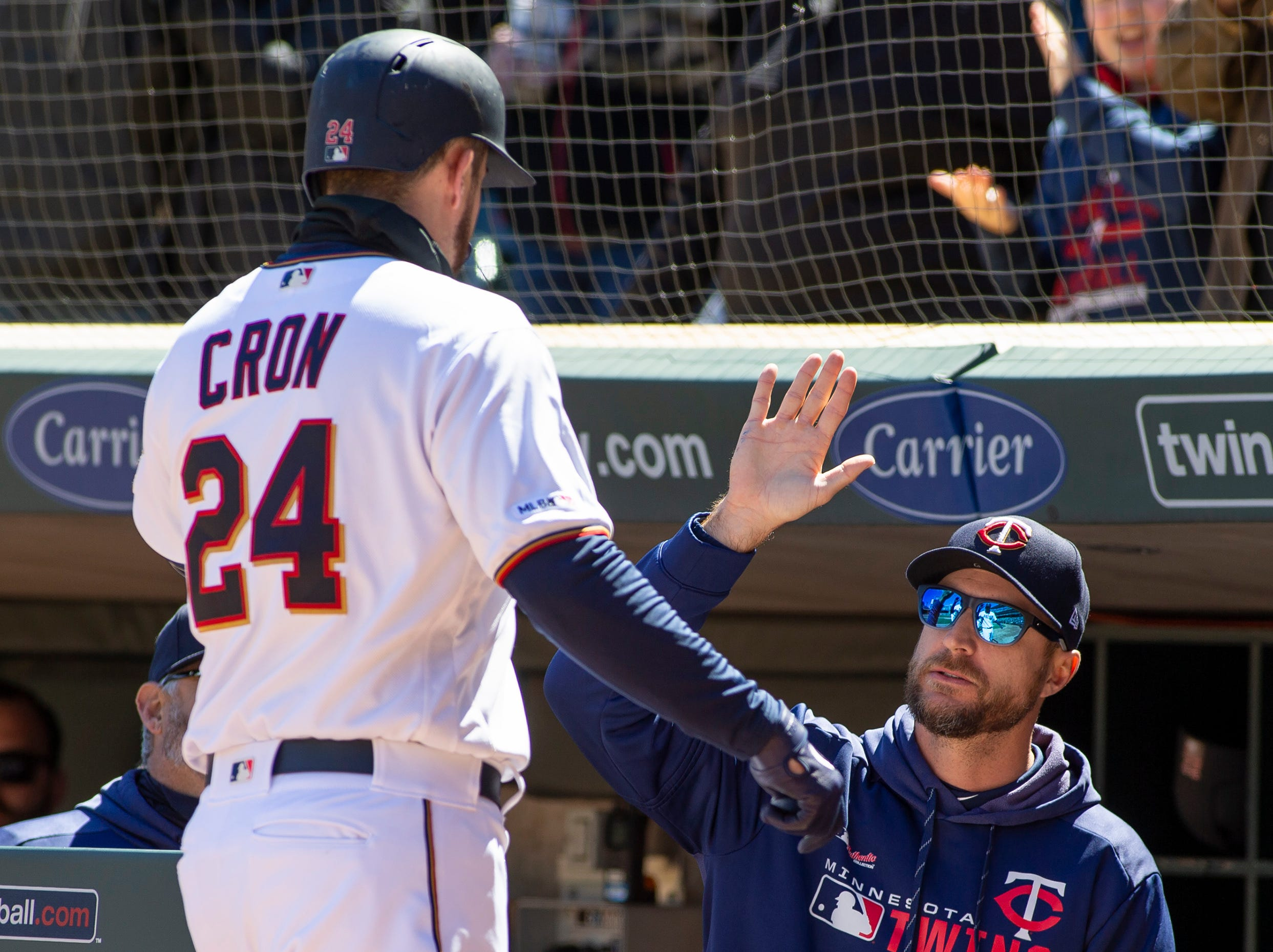 Minnesota Twins' C.J. Cron (24) is congratulated by manager Rocco Baldelli (5) after hitting a two-run home run during the third inning.