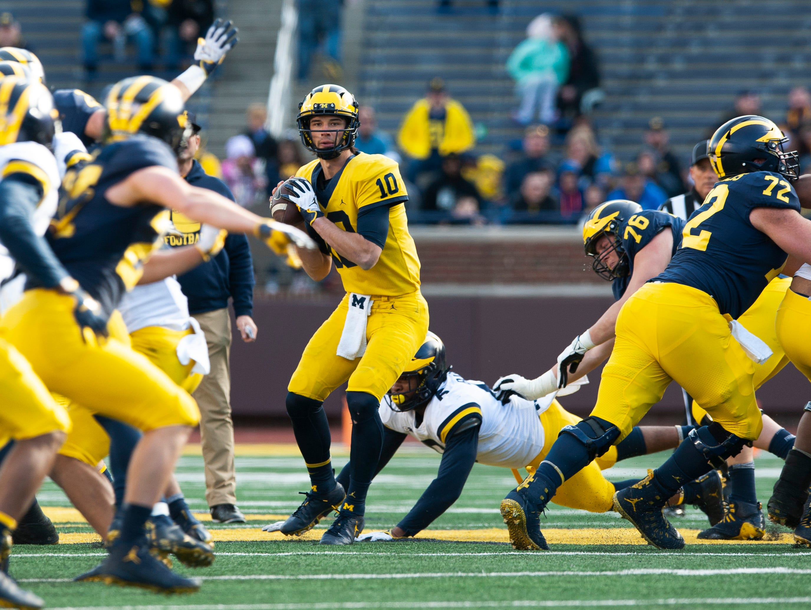 Michigan quarterback Dylan McCaffrey looks for an open receiver as the pocket collapses around him.