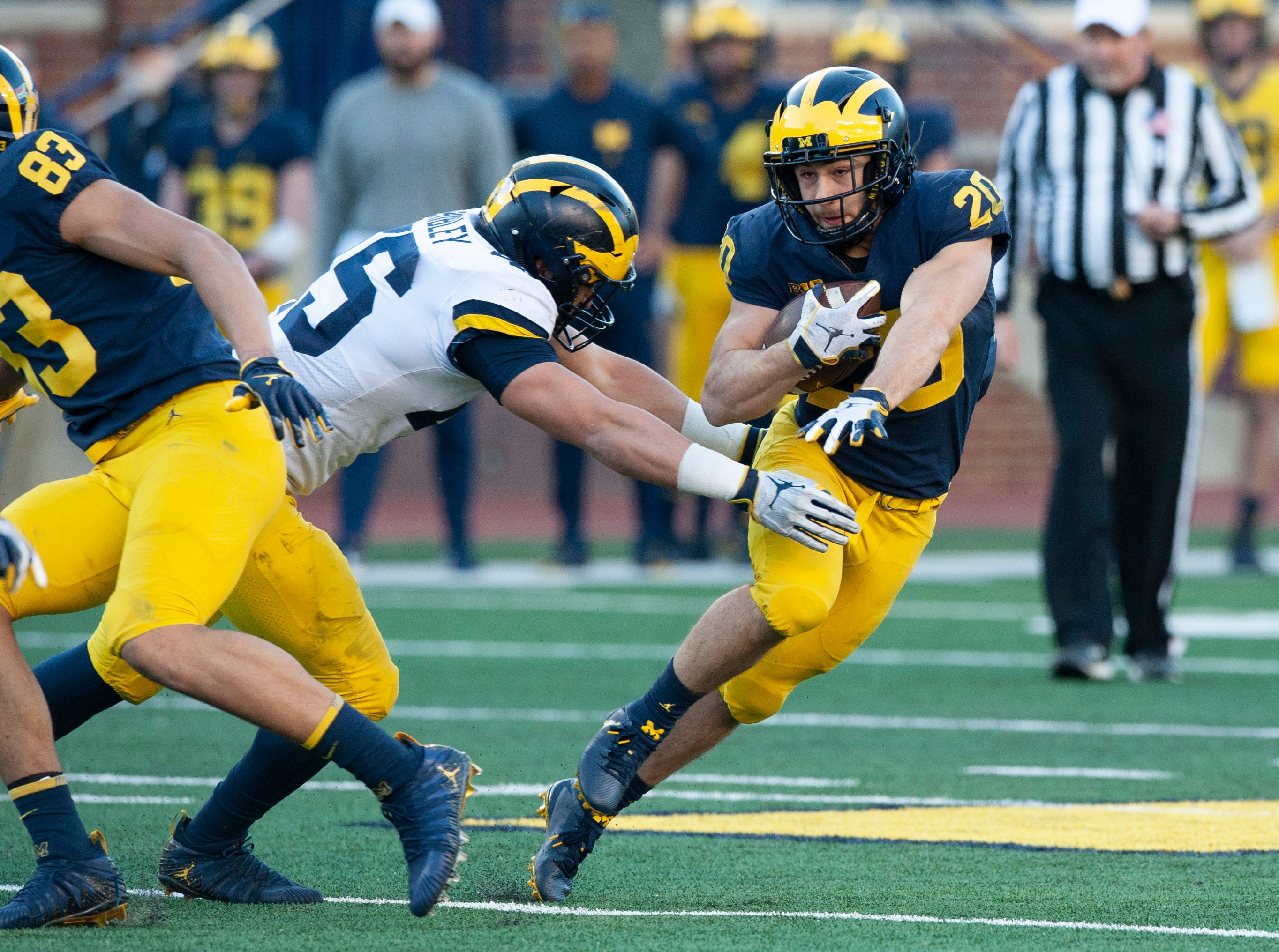 Michigan RB Nicholas Capatina cuts away from a would-be tackler during the scrimmage.