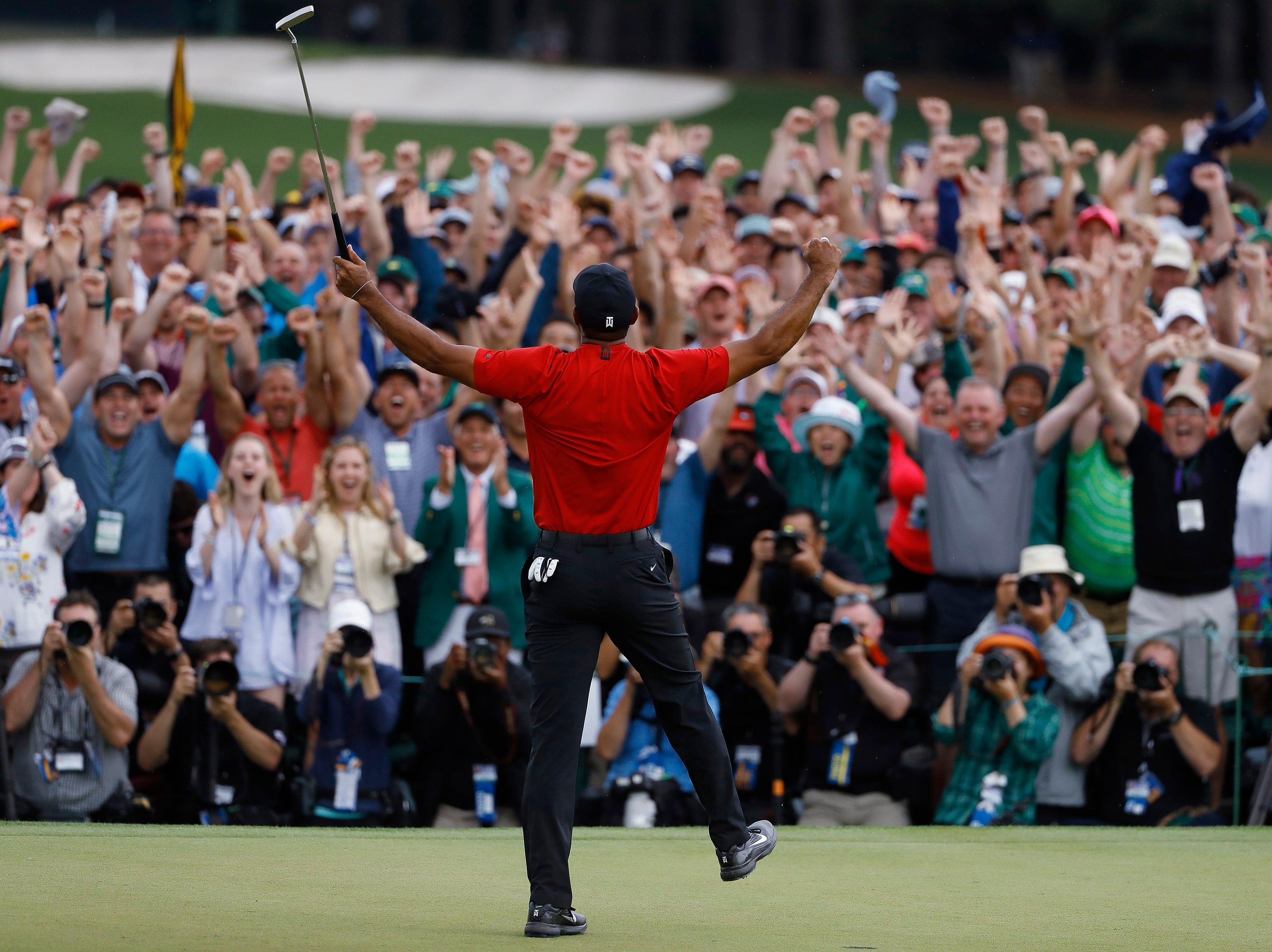 Tiger Woods reacts as he wins the Masters golf tournament Sunday, April 14, 2019, in Augusta, Ga.