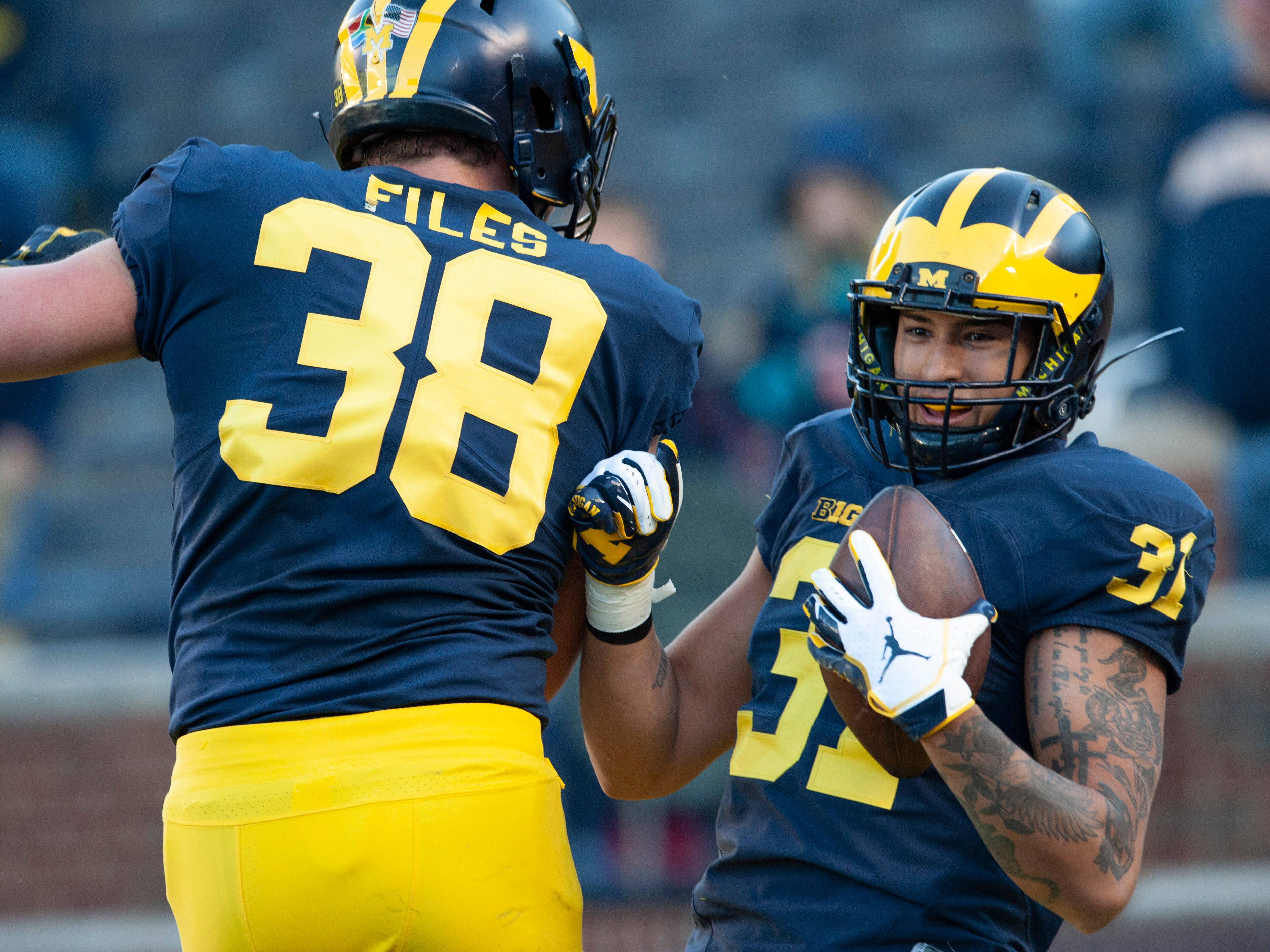 Michigan WR Jack Young (31) celebrates his touchdown reception with teammate Joseph Files.