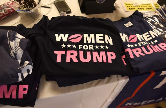 Women for Trump T-shirts are among the merchandise for sale at the Trumperware luncheon.