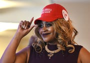Linda Lee Tarver tips her hat during the Women for Trump Style Show.