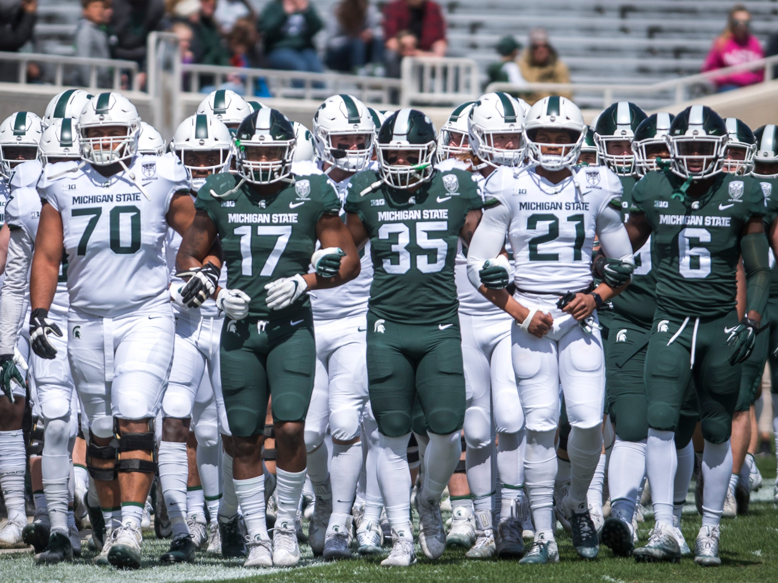 A group of Spartans enter the field.