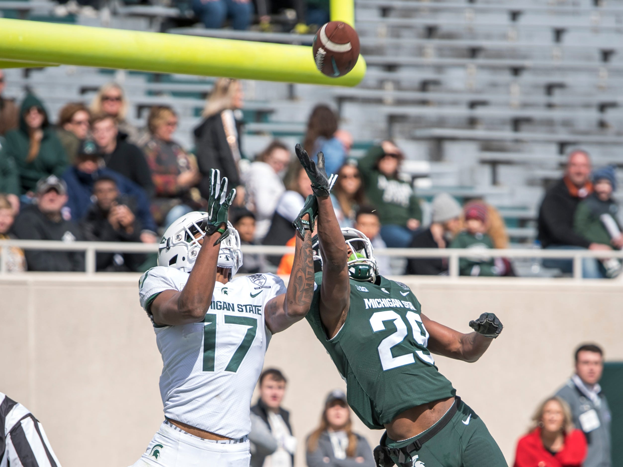 Wide receiver Tre Mosley leaps for a pass while being covered by cornerback Shakur Brown.