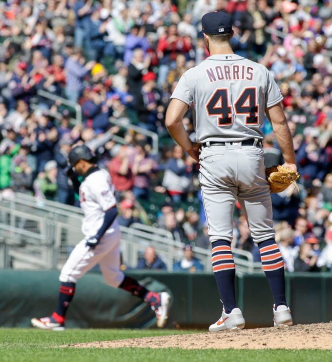 Detroit Tigers starting pitcher Daniel Norris (44) watches Minnesota Twins' Eddie Rosario (20) round the bases on a solo home run during the seventh inning of a baseball game Sunday, April 14, 2019, in Minneapolis. The Twins won 6-4.