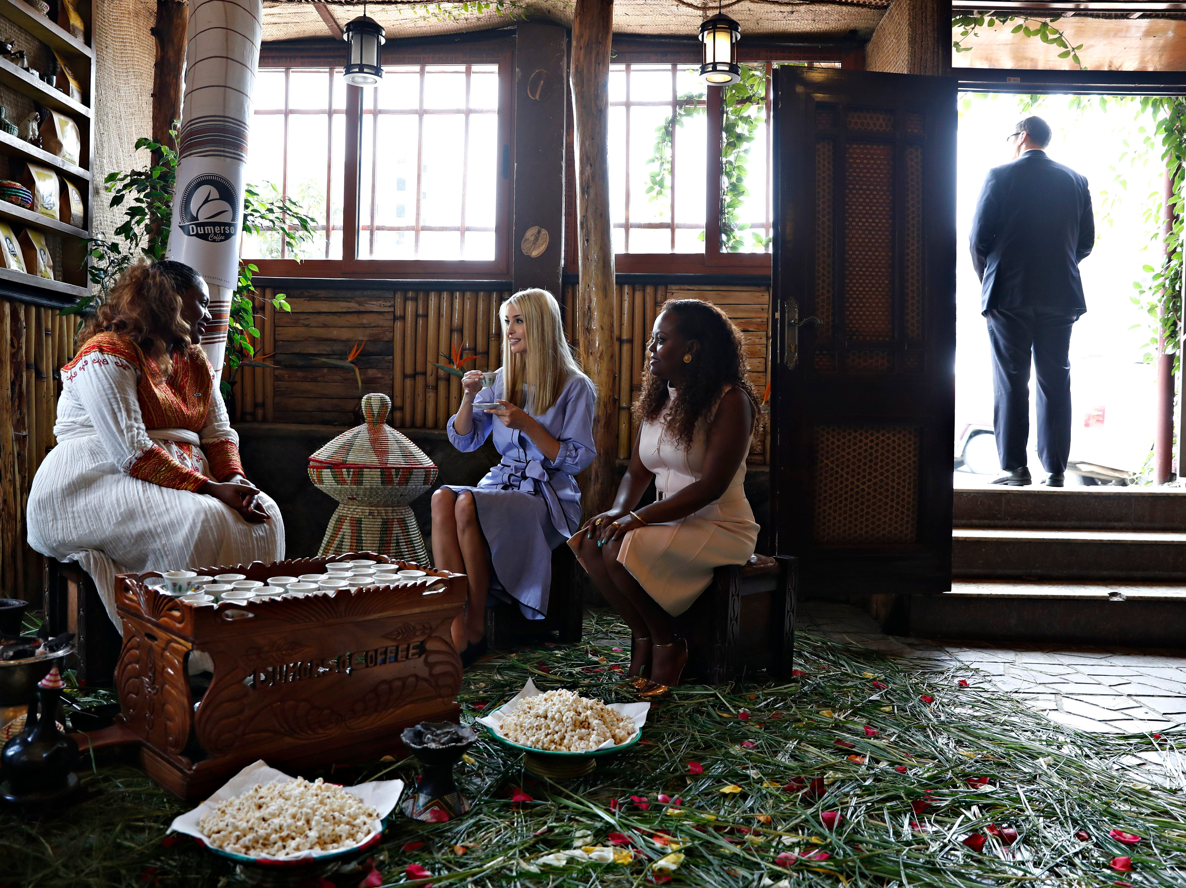 White House senior adviser Ivanka Trump, center, attends a coffee ceremony at Dumerso Coffee, Sunday April 14, 2019, in Addis Ababa, Ethiopia, with Kidist Birhanu, left, and Eleni Melesse, with USAID, right.