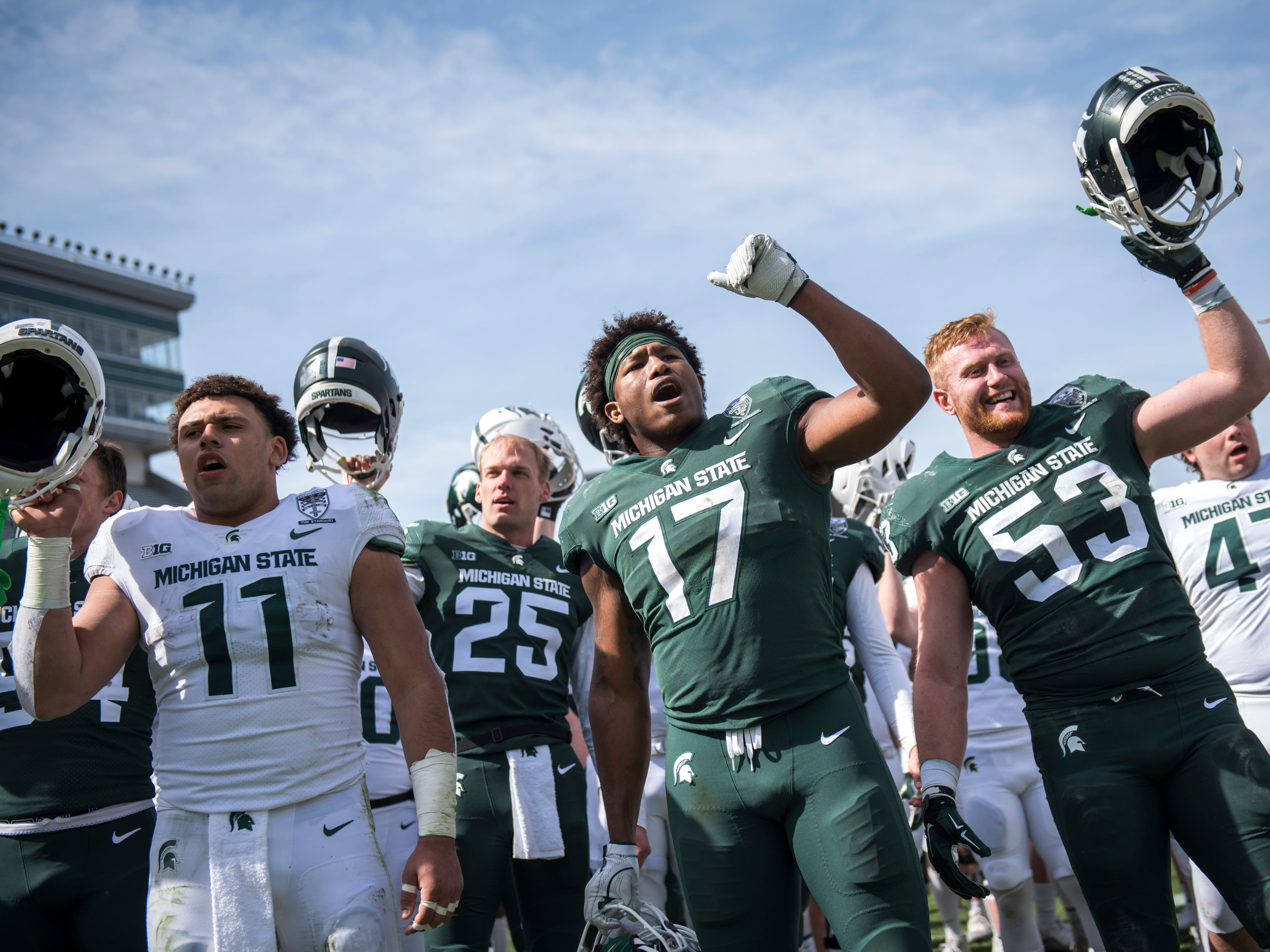 From left, running back Connor Heyward, punter Jake Hartbarger, linebacker Tyriq Thompson and linebacker Peter Fisk sing the fight song.