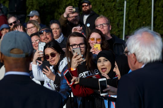 Supporters take photos of U.S. Sen. Bernie Sanders.