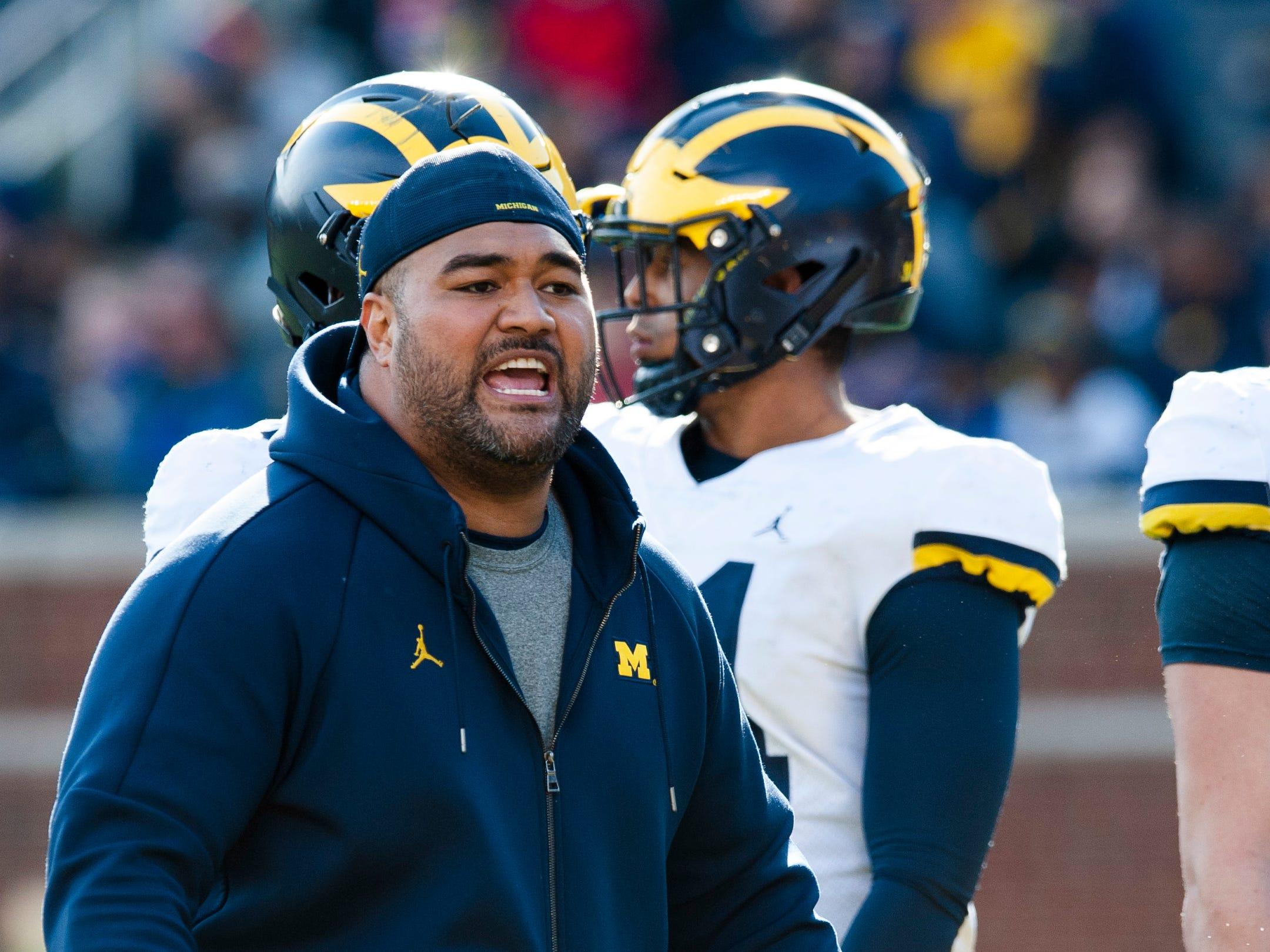 New Michigan defensive line coach Shaun Nua yells at the players.