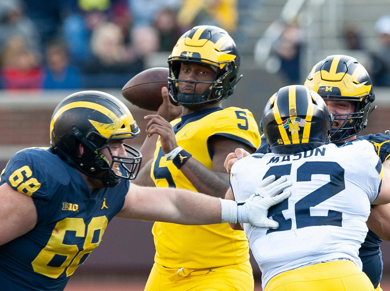 Michigan QB Joe Milton looks for an open receiver.