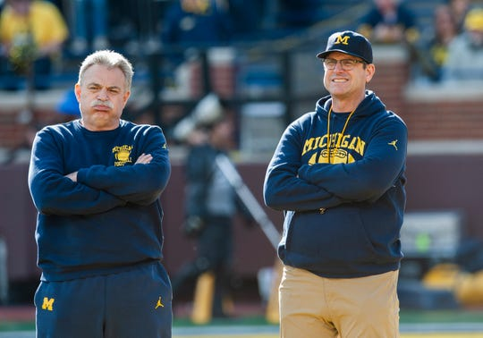 Michigan defensive coordinator Don Brown and head coach Jim Harbaugh at last week's spring scrimmage.