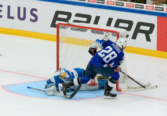 Amanda Kessel of the United States scores a shootout goal past goalkeeper Noora Raty of Finland during the IIHF Women's Ice Hockey World Championships final on Sunday.