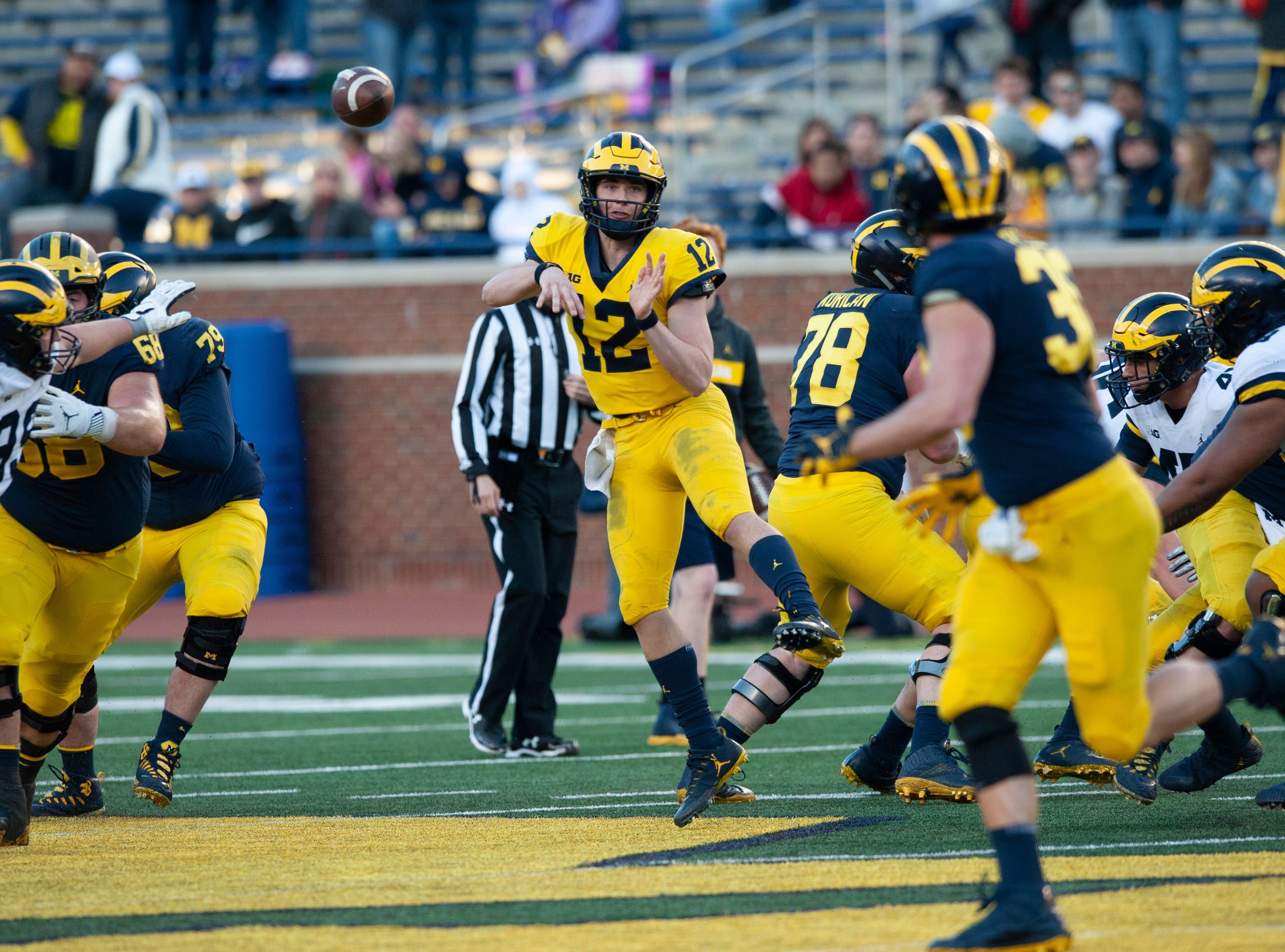 Michigan freshman QB Cade McNamara throws a pass.  *** University of Michigan football spring game at Michigan Stadium in Ann Arbor on Saturday, April 13, 2019. (John T. Greilick, The Detroit News)