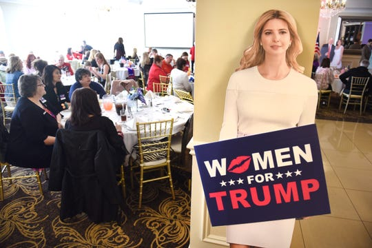A cardboard cutout of first daughter Ivanka Trump greets people attending a Women for Trump luncheon in Flushing, Michigan on Saturday, April 13, 2019. It's one in a series of so-called Trumperware events for female supporters of the president.