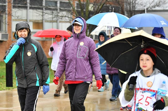 Carla Schneider, left, of Dearborn, and Marilyn Scozeski, of Dearborn, walk together during the Crop Hunger Walk at Lawrence Technological University in Southfield, April 14, 2019.  The walk raise funds and awareness for hunger issues.