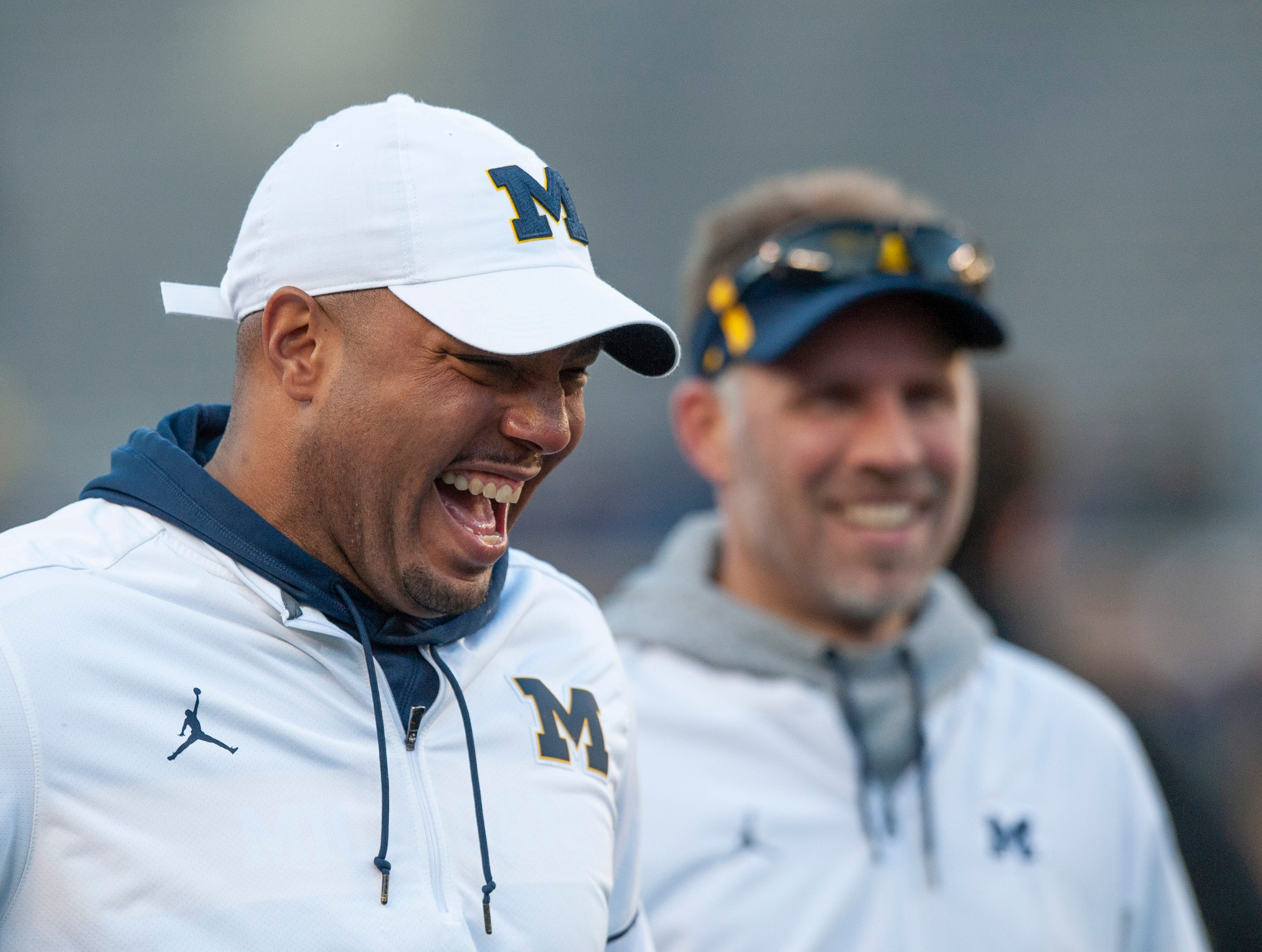 Michigan's new offensive coordinator Josh Gattis, left, is very pleased with a touchdown catch by WR Jack Young during the scrimmage. Also smiling is new quarterbacks coach Ben McDaniels.
