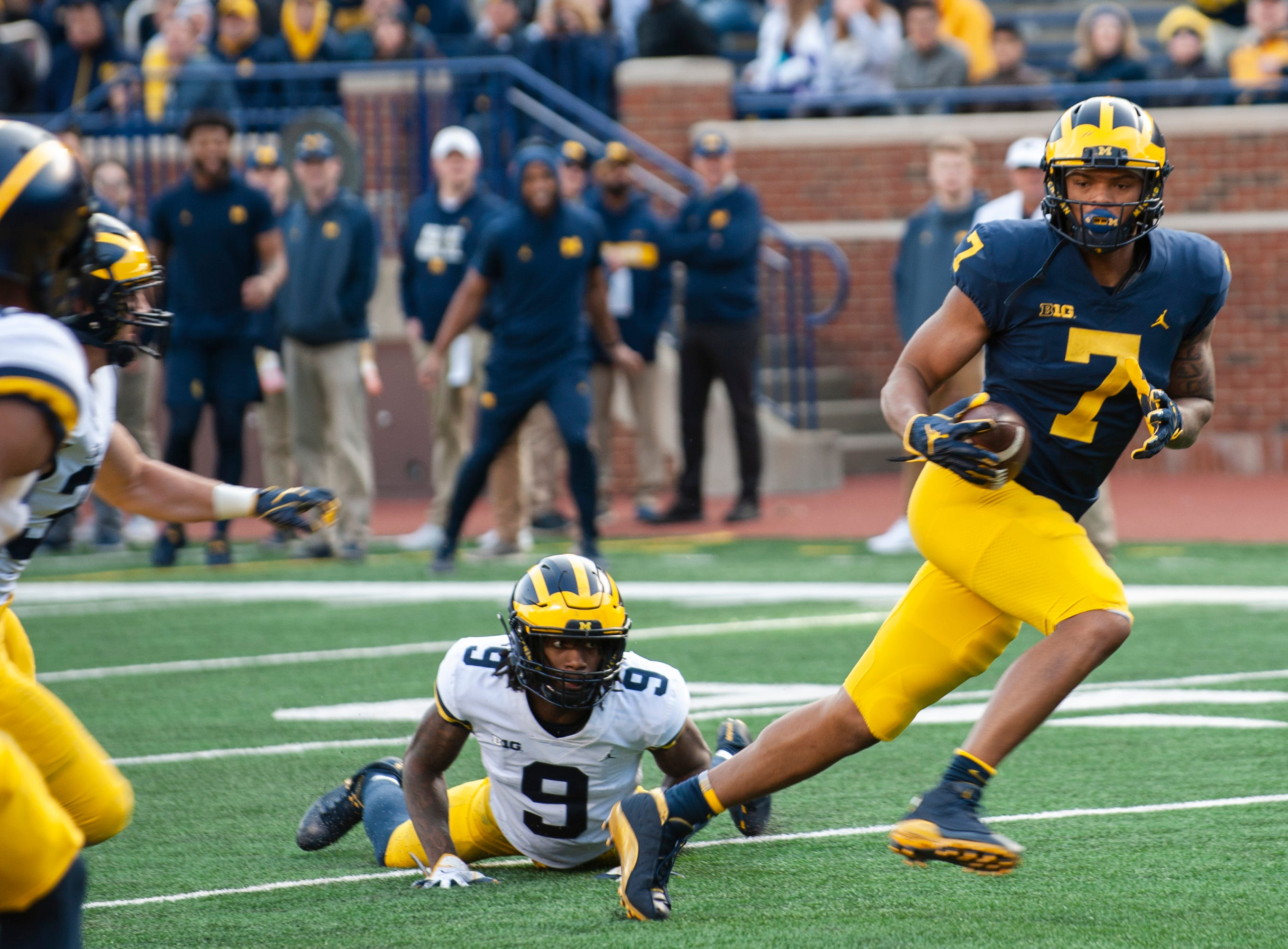 Michigan WR Tarik Black breaks away from DB Gemon Green on his way to the endzone for a touchdown.