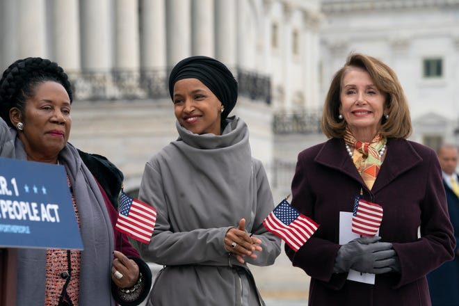 House Speaker Nancy Pelosi, right, announced Sunday that she has taken steps to ensure the safety of Rep. Ilhan Omar, center, following President Donald Trump's retweet of a video that purports to show the Minnesota Democrat being dismissive of the Sept. 11 terrorist attacks.