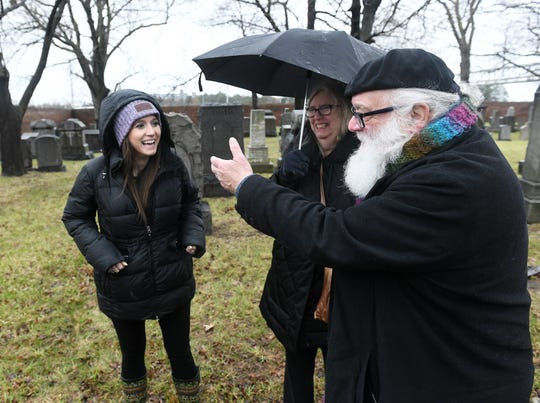 Joseph Roberts, right, 68, of West Bloomfield, talks about his great-grandparents, who are buried at the Beth Olem Cemetery at the GM Detroit Hamtramck Assembly Plant in Detroit. So are the great-great-grandparents of Chelsea Rosenbaum of Southfield, left.