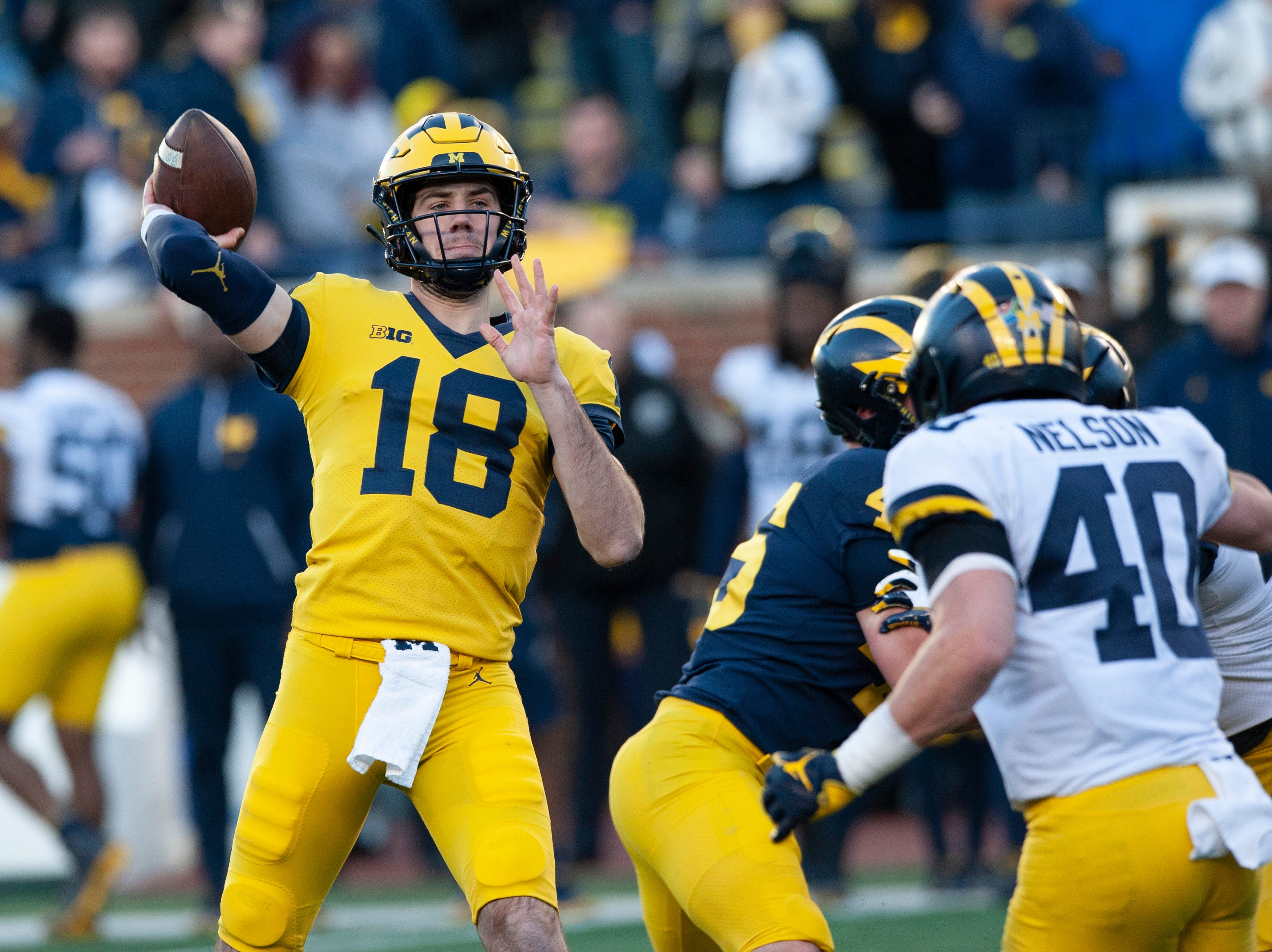 Michigan QB Brandon Peters throws a pass during the scrimmage.
