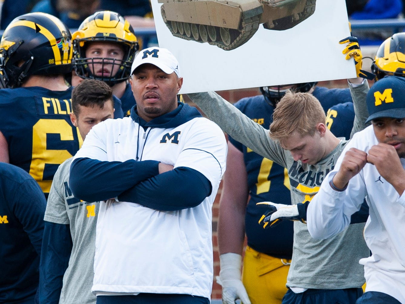 Michigan's new offensive coordinator Josh Gattis watches the scrimmage from the offensive players' sideline.
