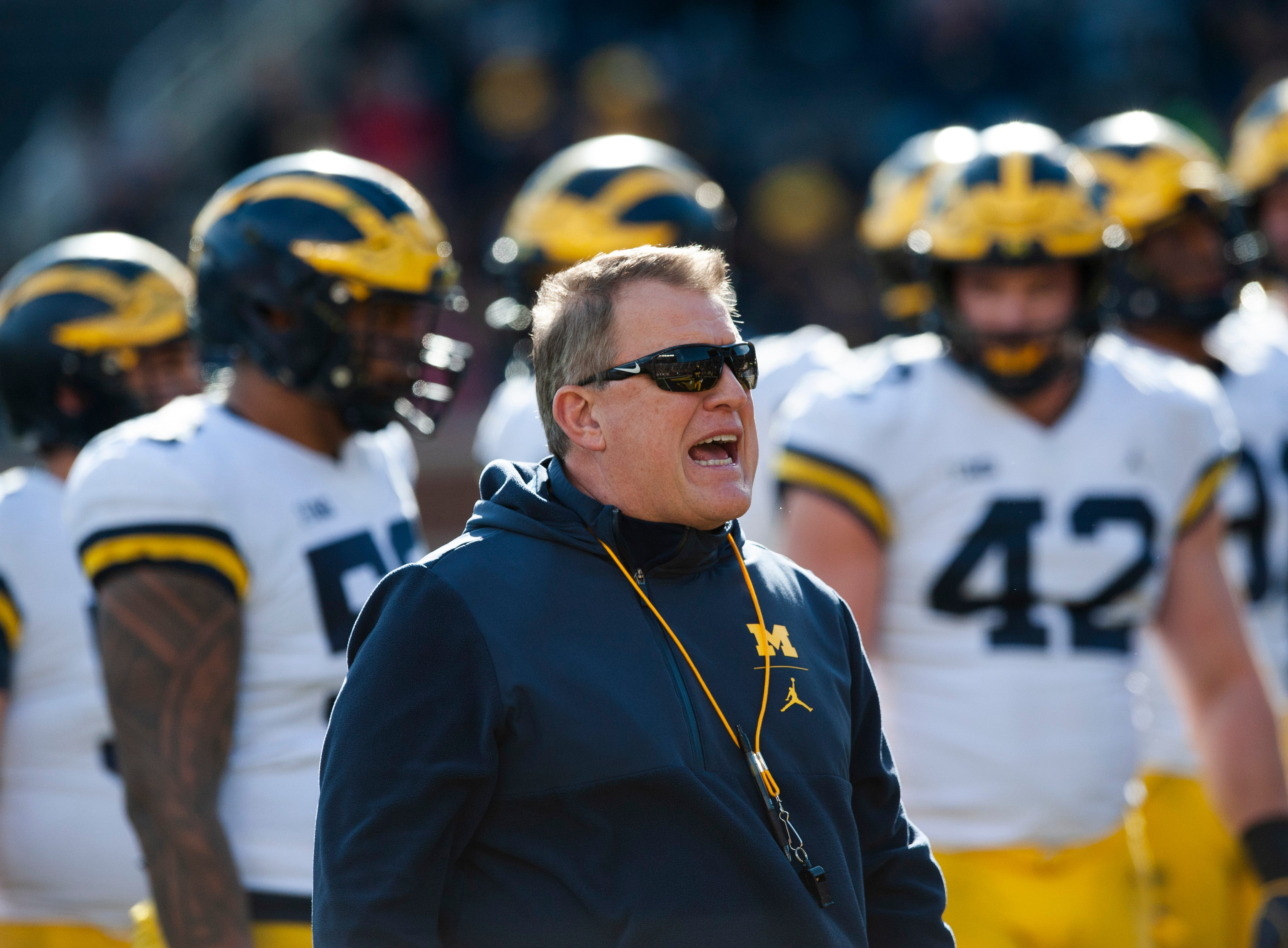 Michigan offensive line coach Ed Warinner yells at the players.