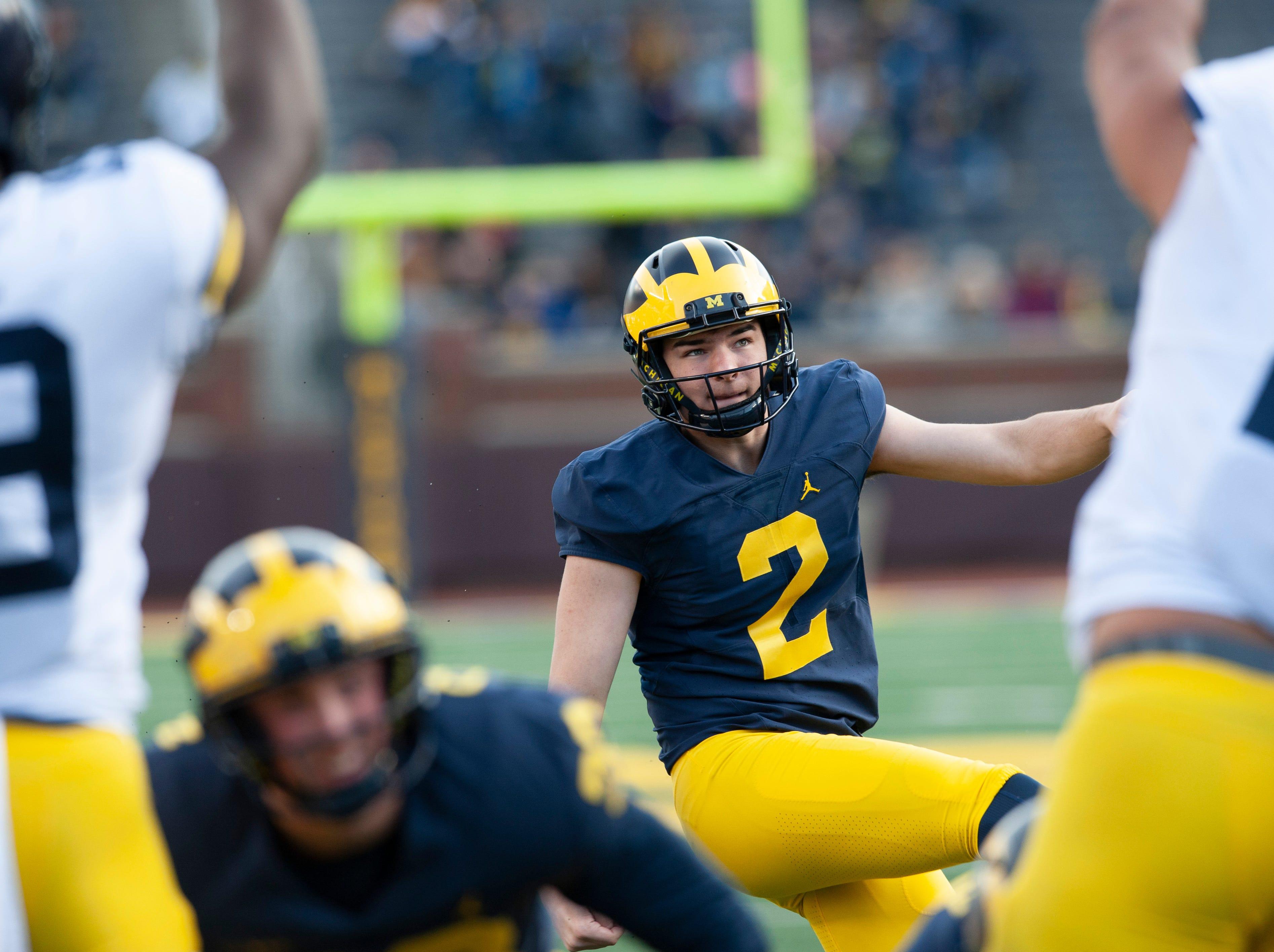 Michigan kicker Jake Moody boots a field goal.