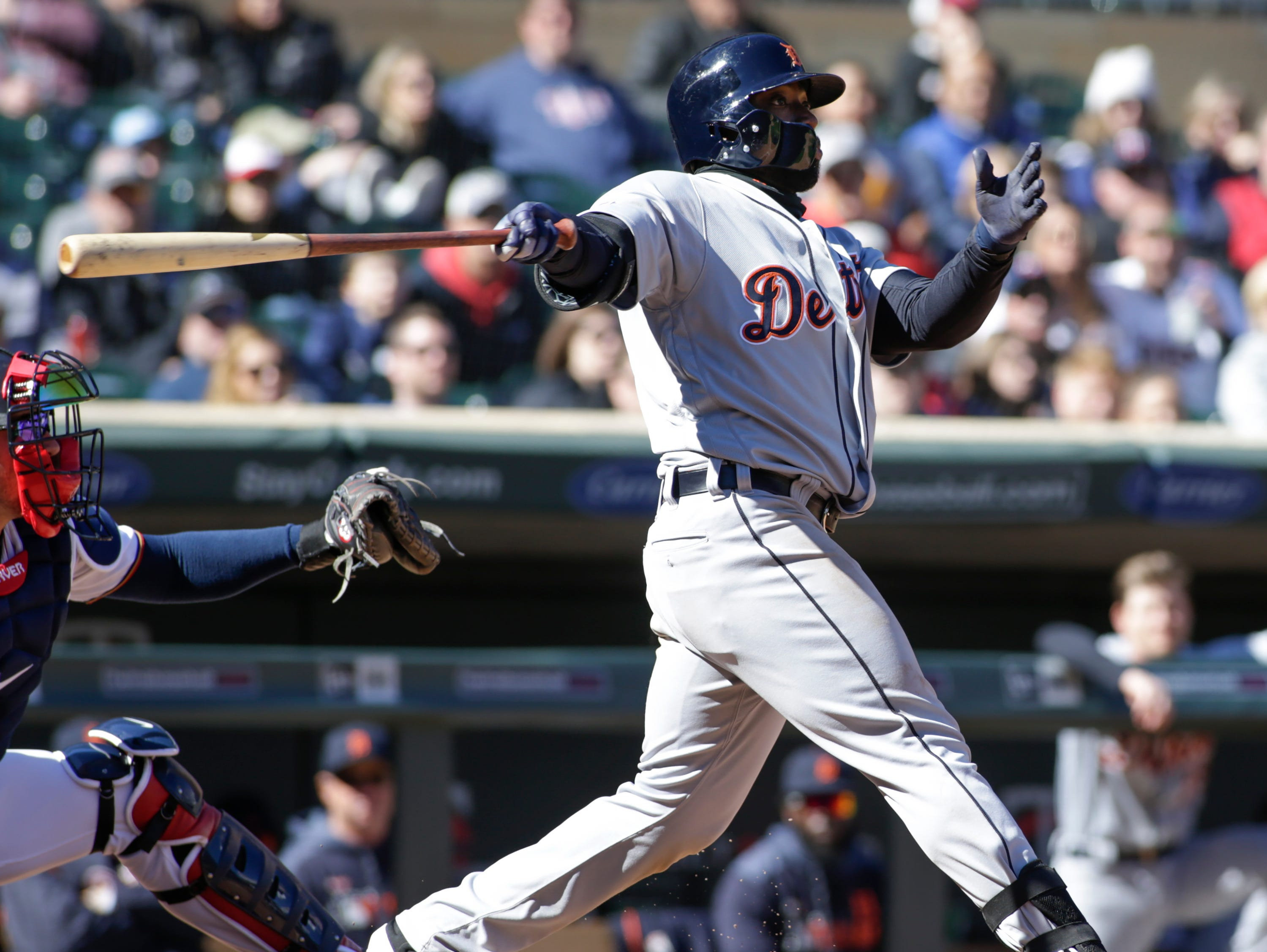 Detroit Tigers' Christin Stewart (14) follows through on an RBI-double during the eighth inning.