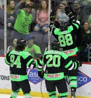 Brandon Vuic (88) of Elmira celebrates after scoring the first home playoff goal in team history during Game 2 of the Federal Hockey League semifinal series between the Enforcers and Watertown Wolves on April 13, 2019 at Elmira's First Arena. Also pictured are Brendan Hussey (94) and Dmytro Babenko (20).