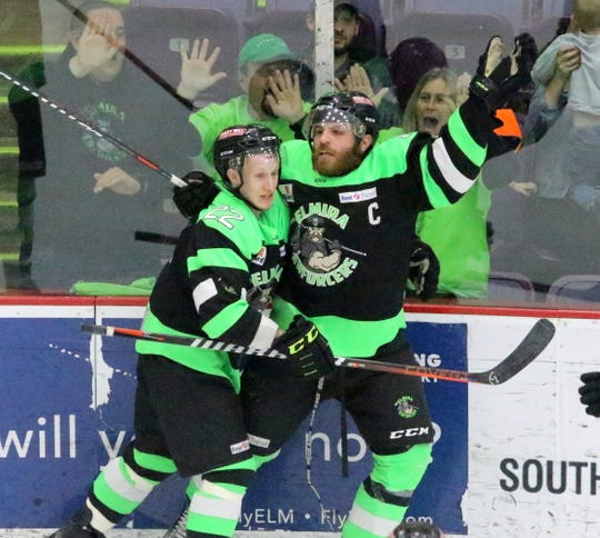 Elmira's Ahmed Mahfouz, right, celebrates with Stepan Timofeyev (22) after scoring for the Enfercers during  Game 2 of their Federal Hockey League semifinal series against the Watertown Wolves on April 13, 2019 at Elmira's First Arena.