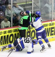 Ahmed Mahfouz, upper left, of the Elmira Enforcers tangles with Watertown's Egor Kostyukov (3) and Aleh Shypiitsyn (68) after a whistle in Game 2 of the Federal Hockey League semifinal series between the Enforcers and Wolves on April 13, 2019 at Elmira's First Arena.