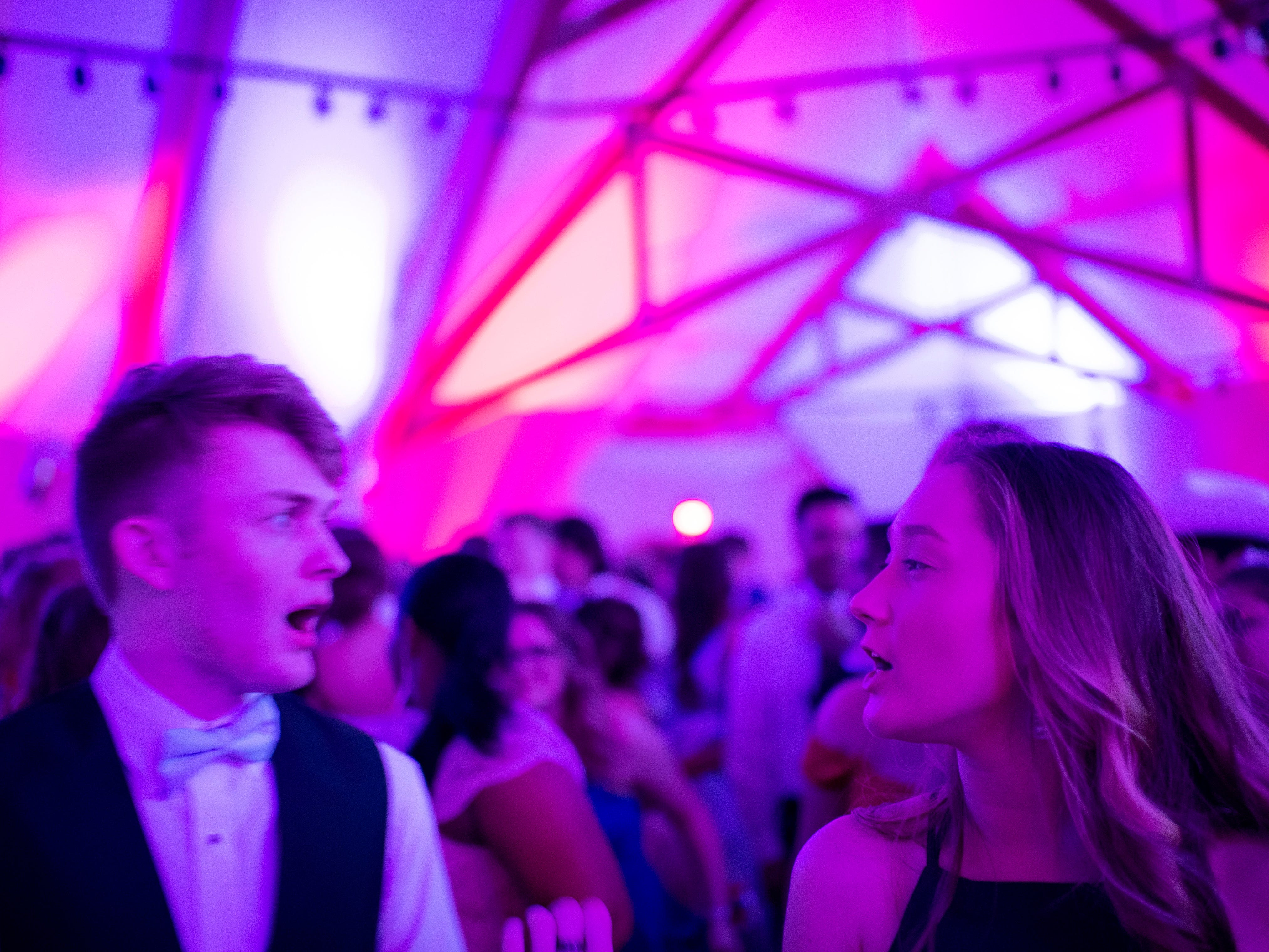 """Harrison seniors Nate Flamion, left, and Sunnie Bernind share a dance at """"The Greatest Prom on Earth"""" at Milestones Saturday night."""