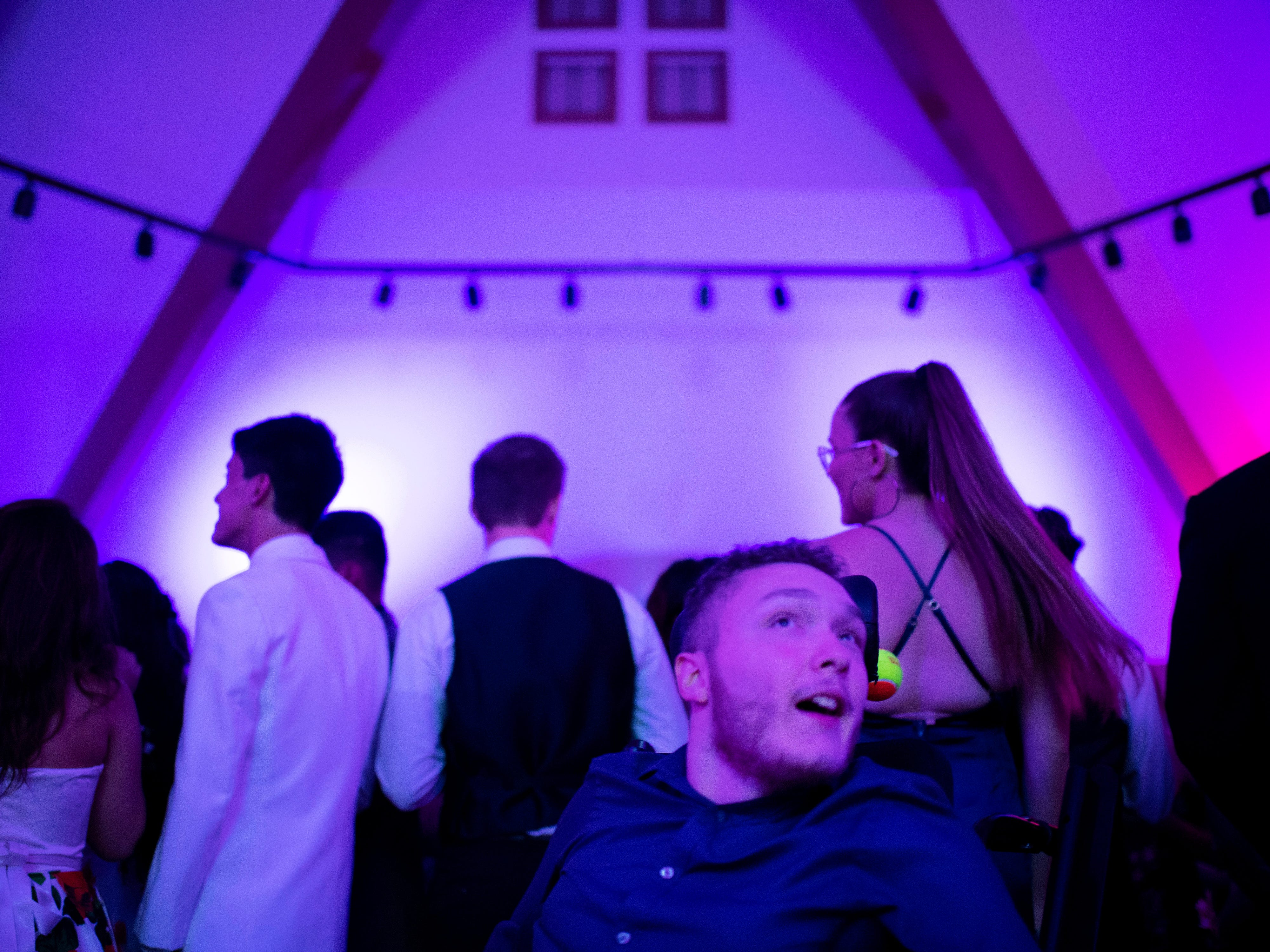 """Zachary Palmer, 18, pops wheelies and moves to the grooves at """"The Greatest Prom on Earth"""" at Milestones Saturday night."""