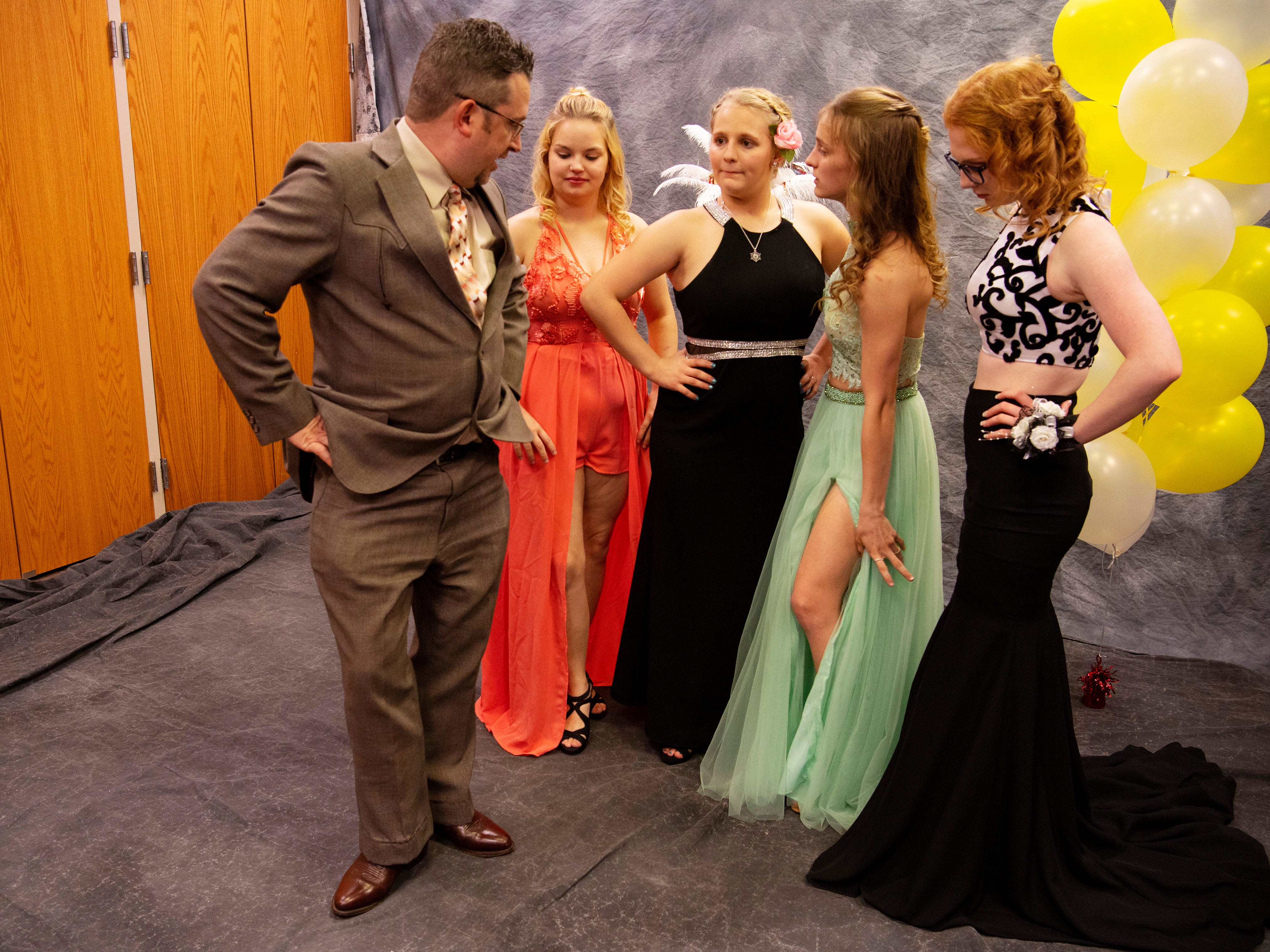 """Nathan Zollner, a photographer with Straub Photography, helps a group of Harrison students with their portrait poses  at """"The Greatest Prom on Earth"""" at Milestones Saturday night."""