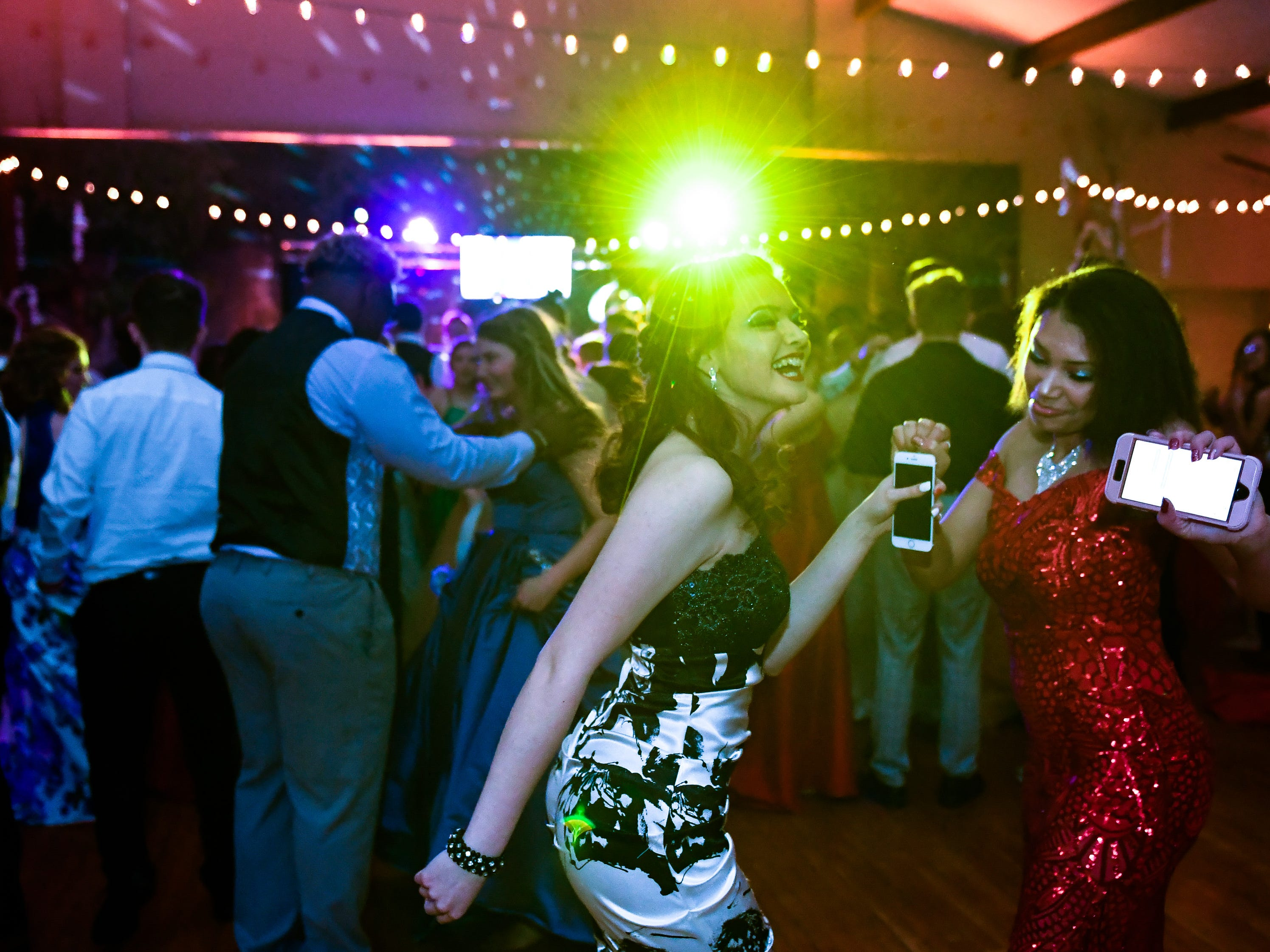 Daylynn Hogan, left, and Ashlyn Miller on the dance floor at the Reitz  High chool Prom held at the Vanderburgh 4-H Center Saturday, April 13, 2019.