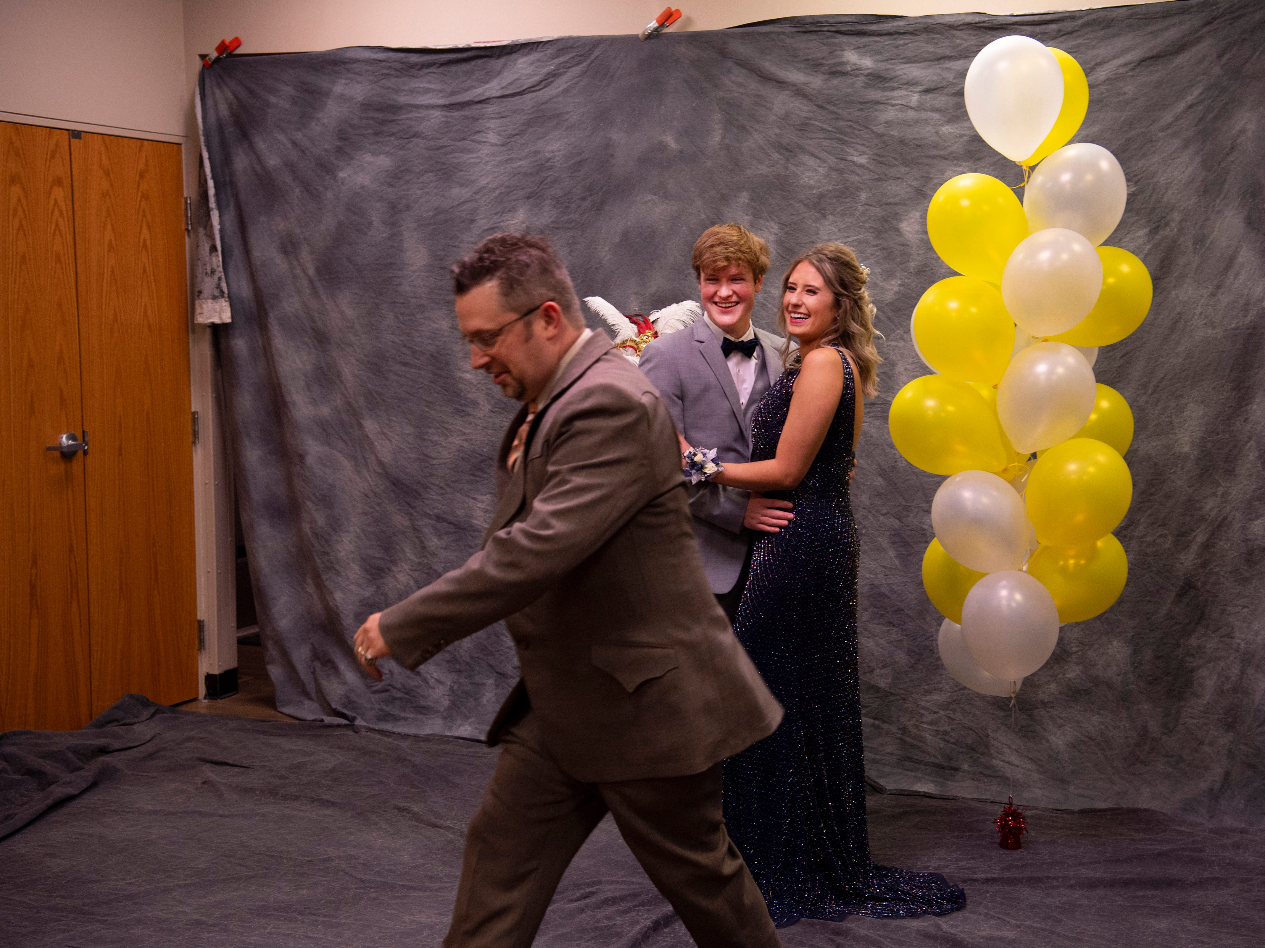 """Harrison senior Carter Elkins and his date,  Jordan Whalen, a freshman at Indiana University, have their prom pictures made by Nathan Zollner with Straub Photography at """"The Greatest Prom on Earth"""" at Milestones Saturday night."""