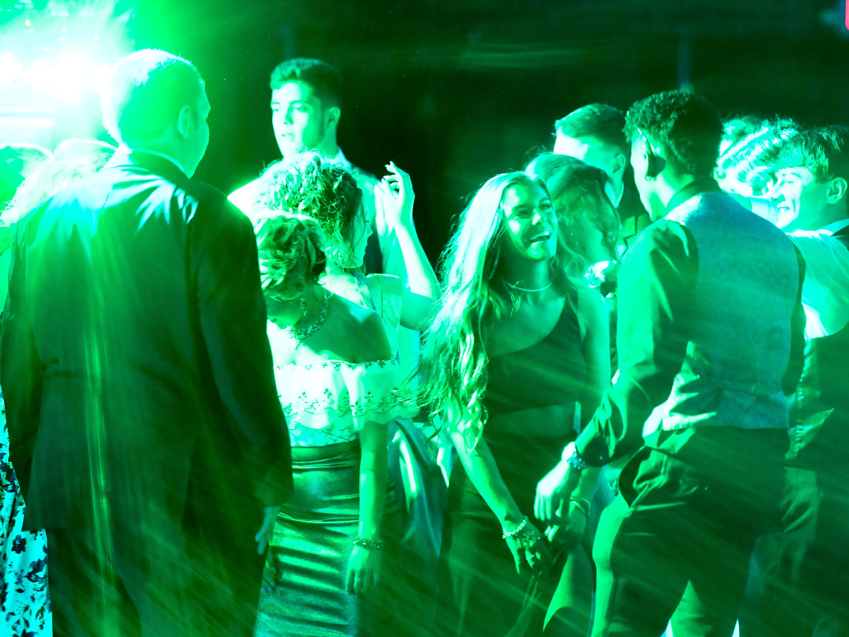 Colored lights play across the dance floor at the Henderson County High Prom held at Colonel Gym Saturday, April 13, 2019.