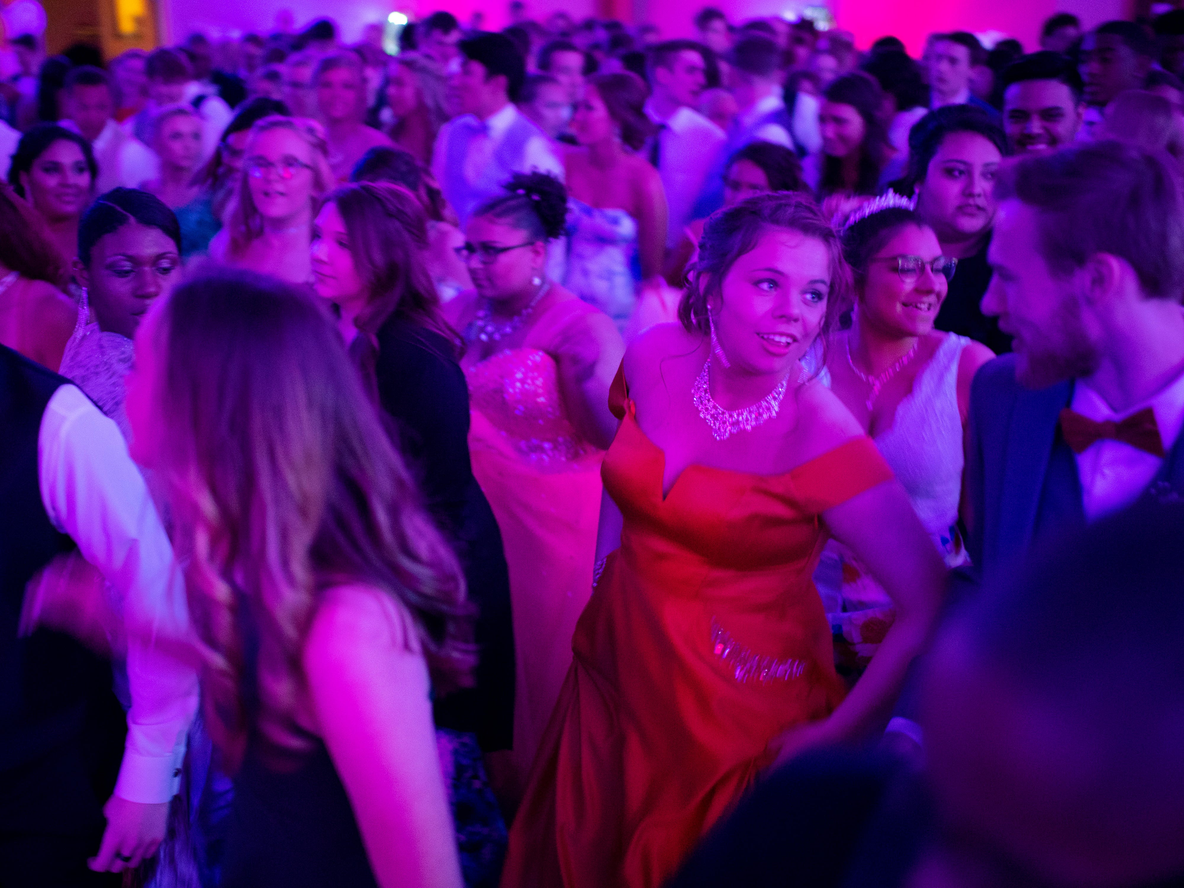 """The Harrison prom attendees gather for a line dance at """"The Greatest Prom on Earth"""" at Milestones Saturday night."""