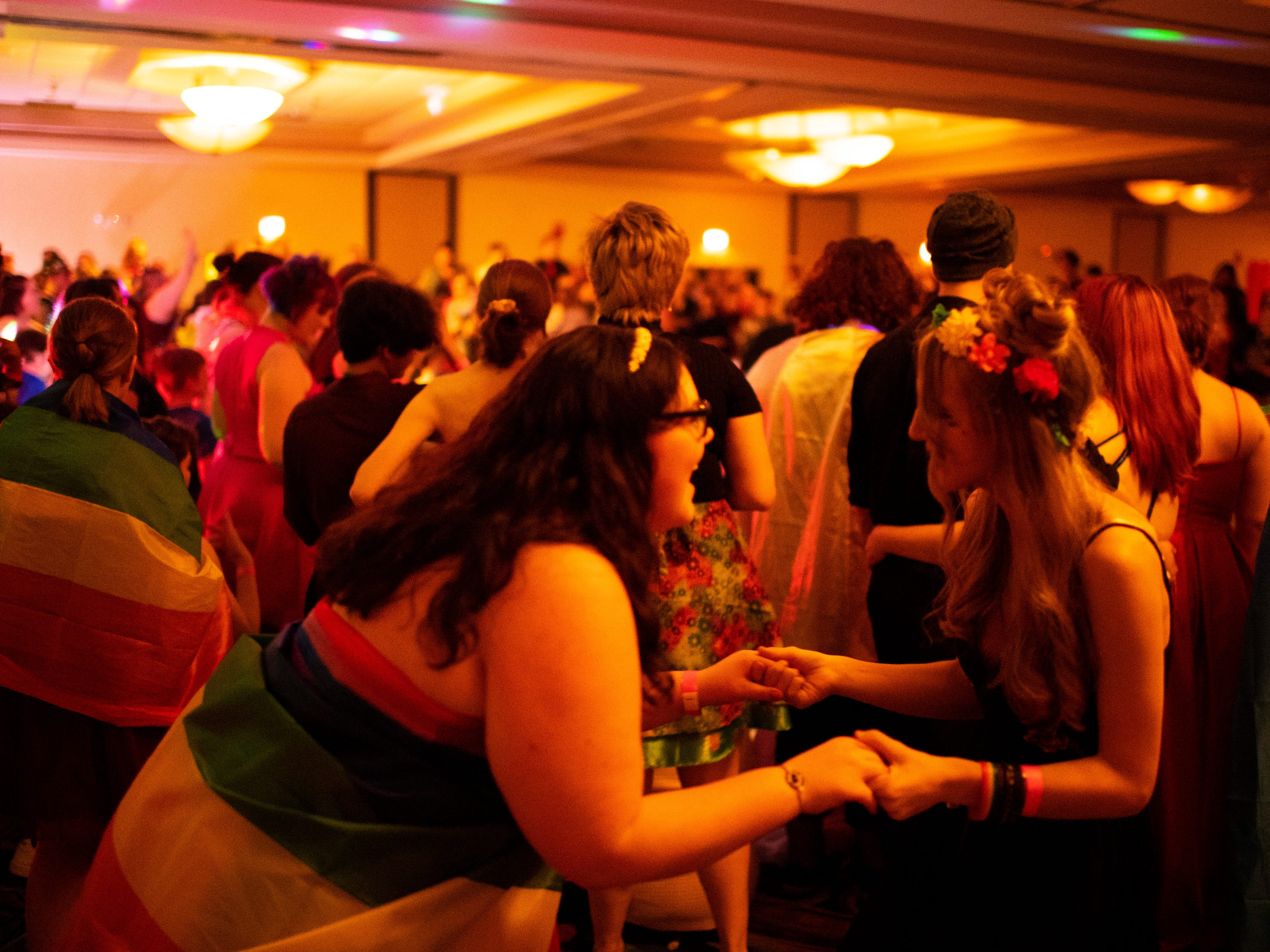 Serin Stone, 16, left, and her date who declined to give her name, dance at the Tri-State Alliance Pride Prom at the Holiday Inn Saturday night.