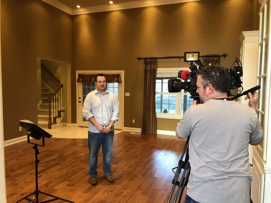 "Mark Royer gets in front of the camera while filming an episode of the HGTV reality series ""House Hunters."""
