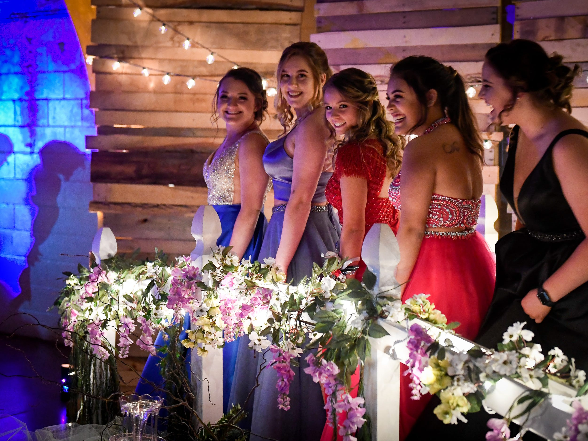 Posing for photos, left to right, Olivia Goebel, Berkeley Frankenberger, Jaicc Hedge, Molly Rivera and Lydia Lenfers at the Reitz High School Prom held at the Vanderburgh 4-H Center Saturday, April 13, 2019.